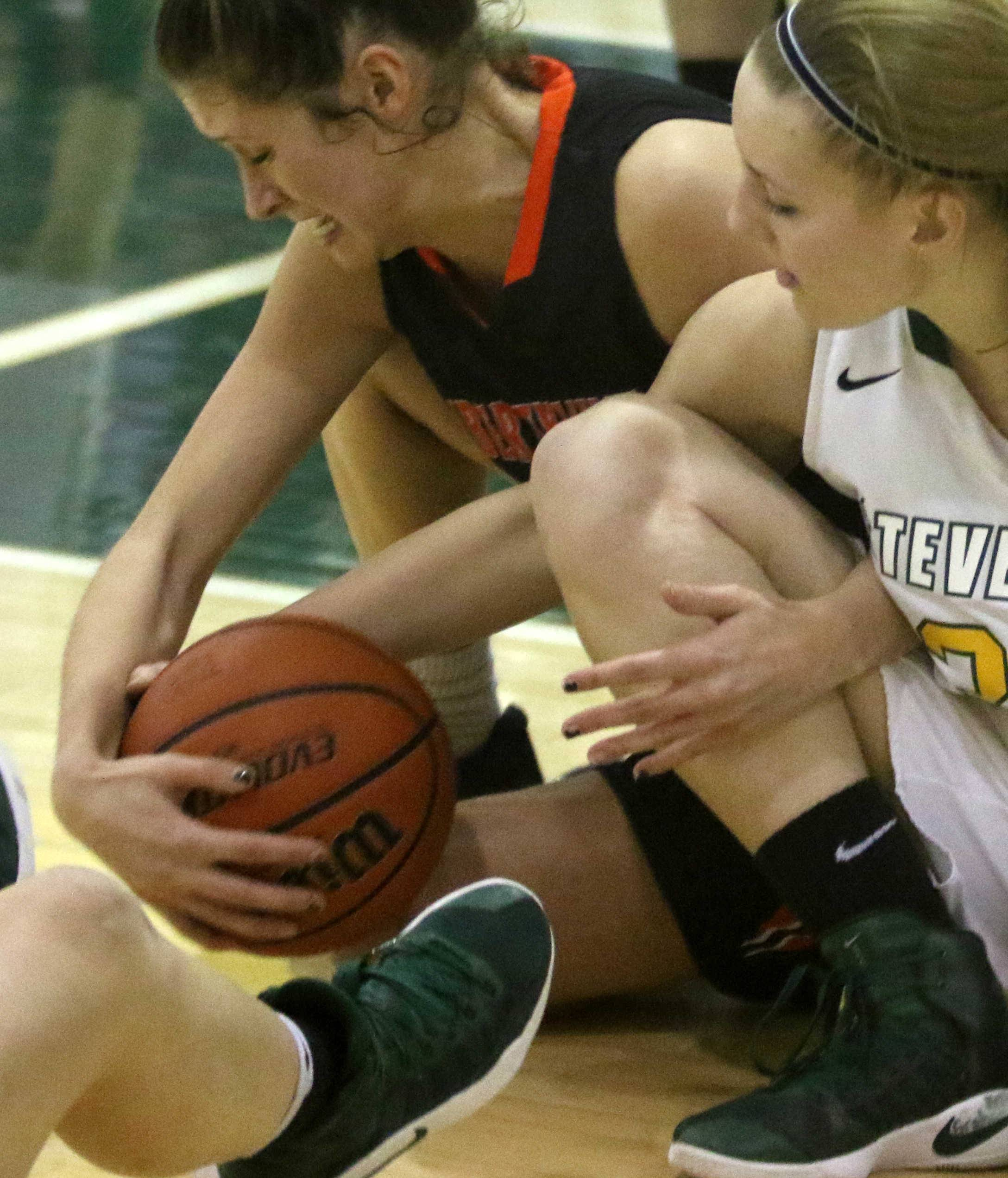 Libertyville's Claire Keefe, left, and Stevenson's Madison Wicklund battle for the ball during Class 4A regional title game action at Stevenson.