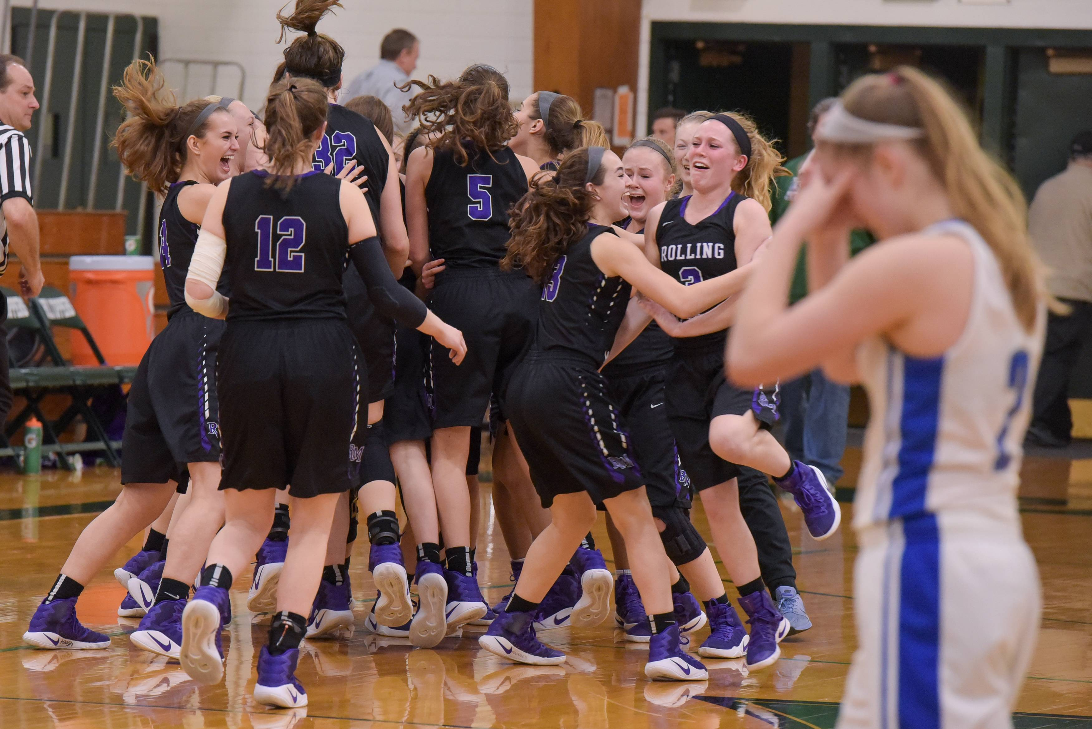 Rolling Meadow celebrates winning the Class 4A sectional semifinal girls basketball game 43-40 over Wheaton North Monday at Glenbard West.