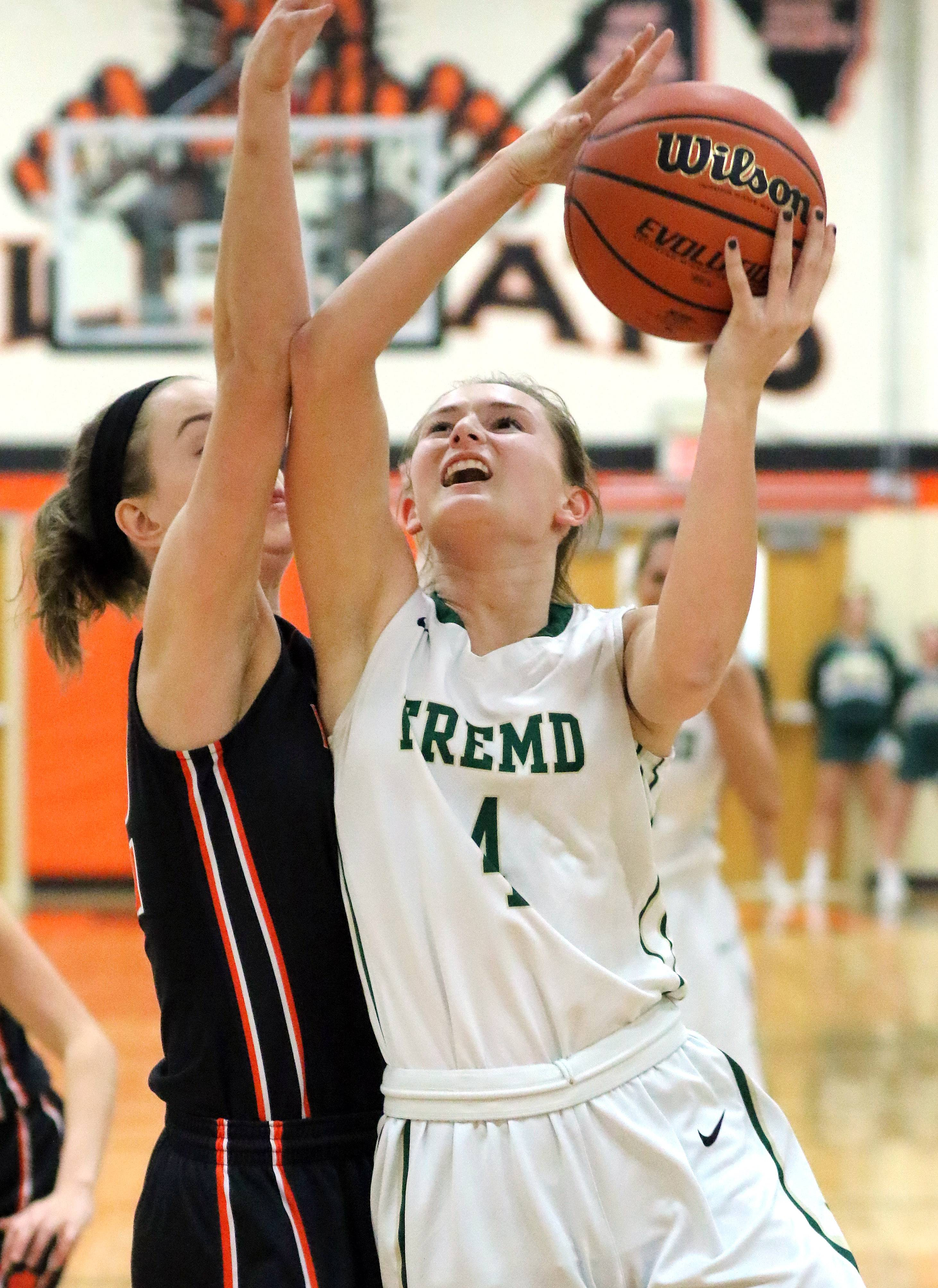 Fremd's Missy Adrian, right, drives on Libertyville's Caroline Frea during Class 4A sectional semifinal play Monday at Libertyville.