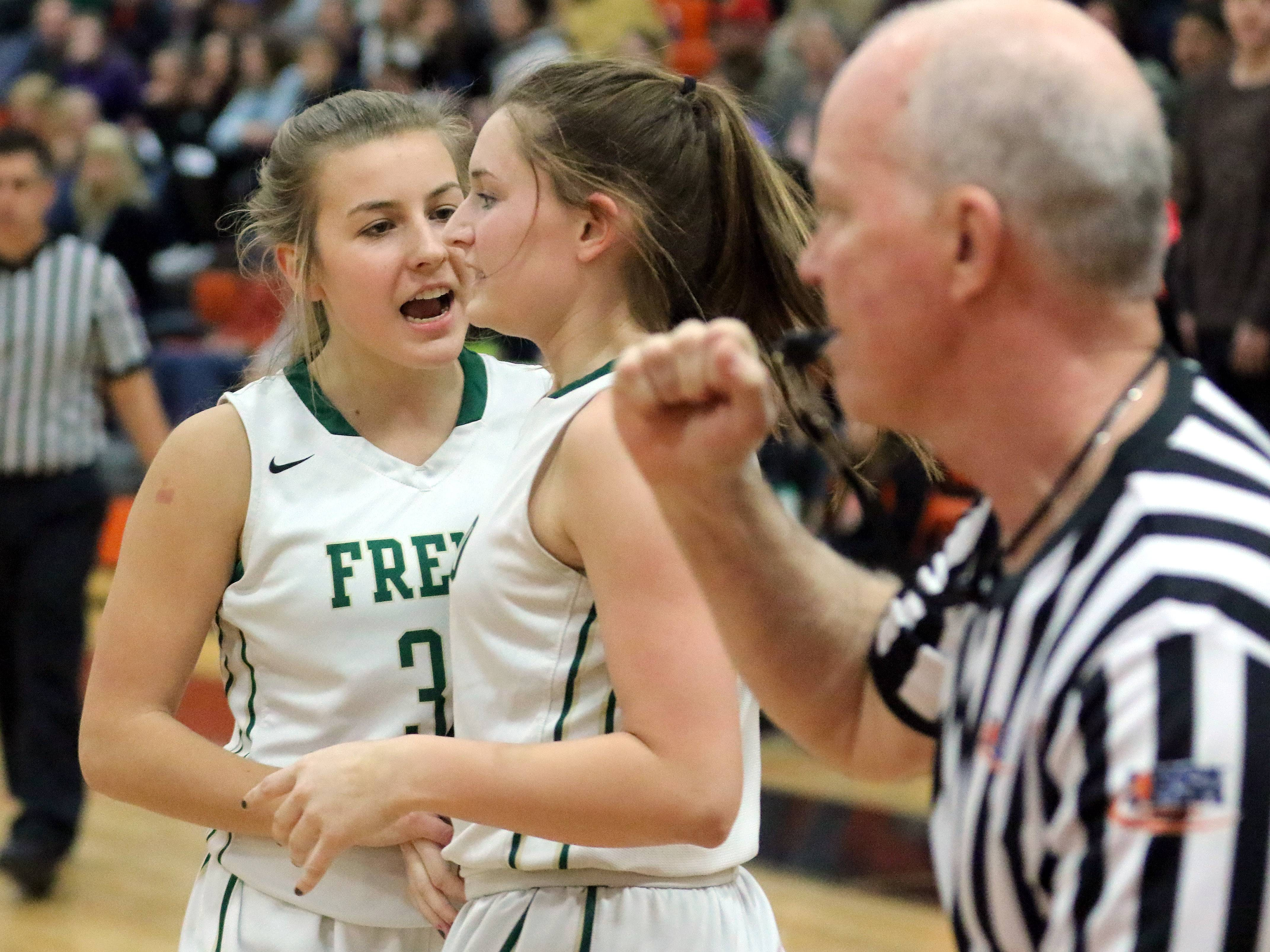 Fremd's Emily Klaczek, left, celebrates with Missy Adrian after drawing a foul during Class 4A sectional semifinal play Monday at Libertyville.