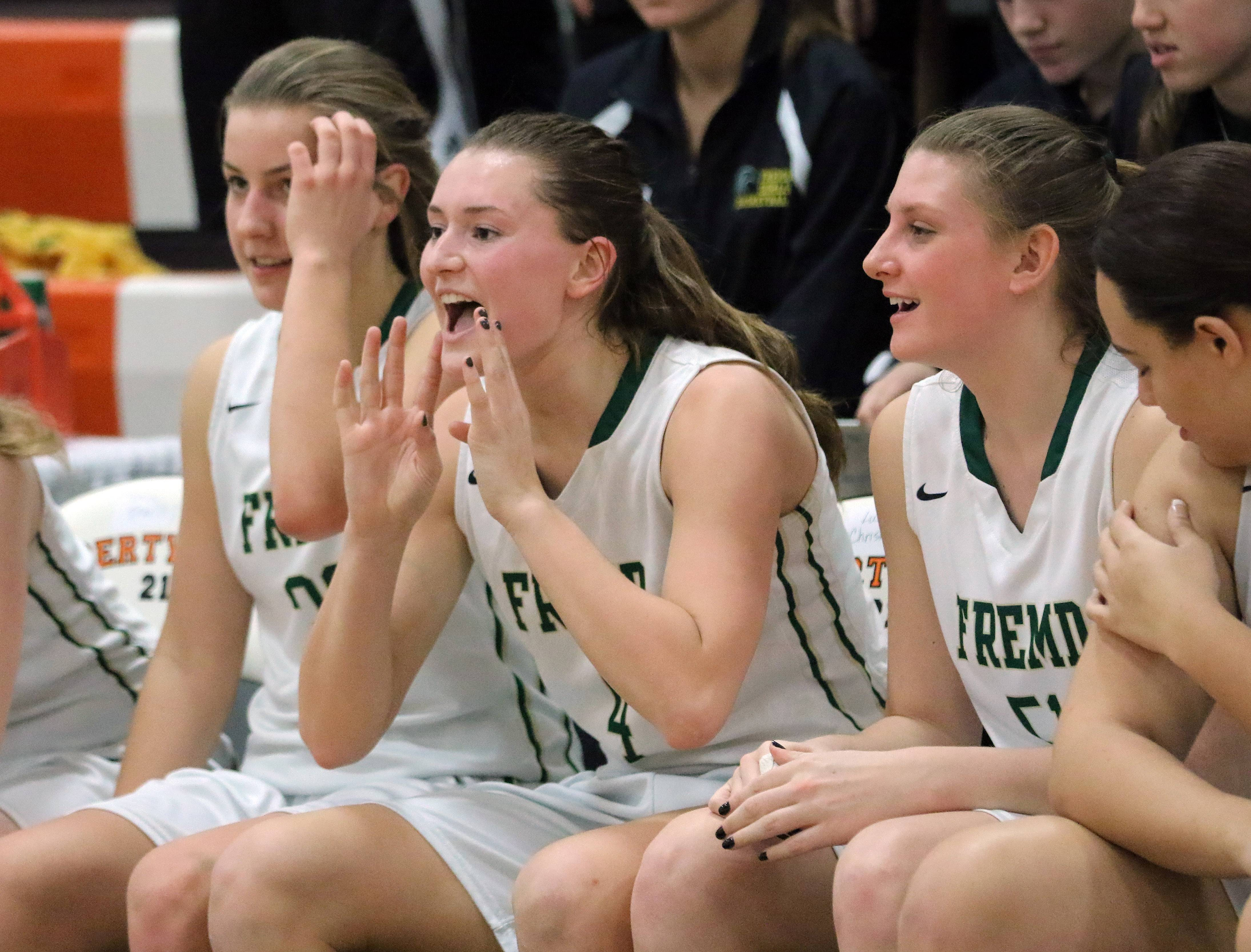 Fremd's Missy Adrian cheers on the bench during the Vikings' win in Class 4A sectional semifinal play Monday at Libertyville.