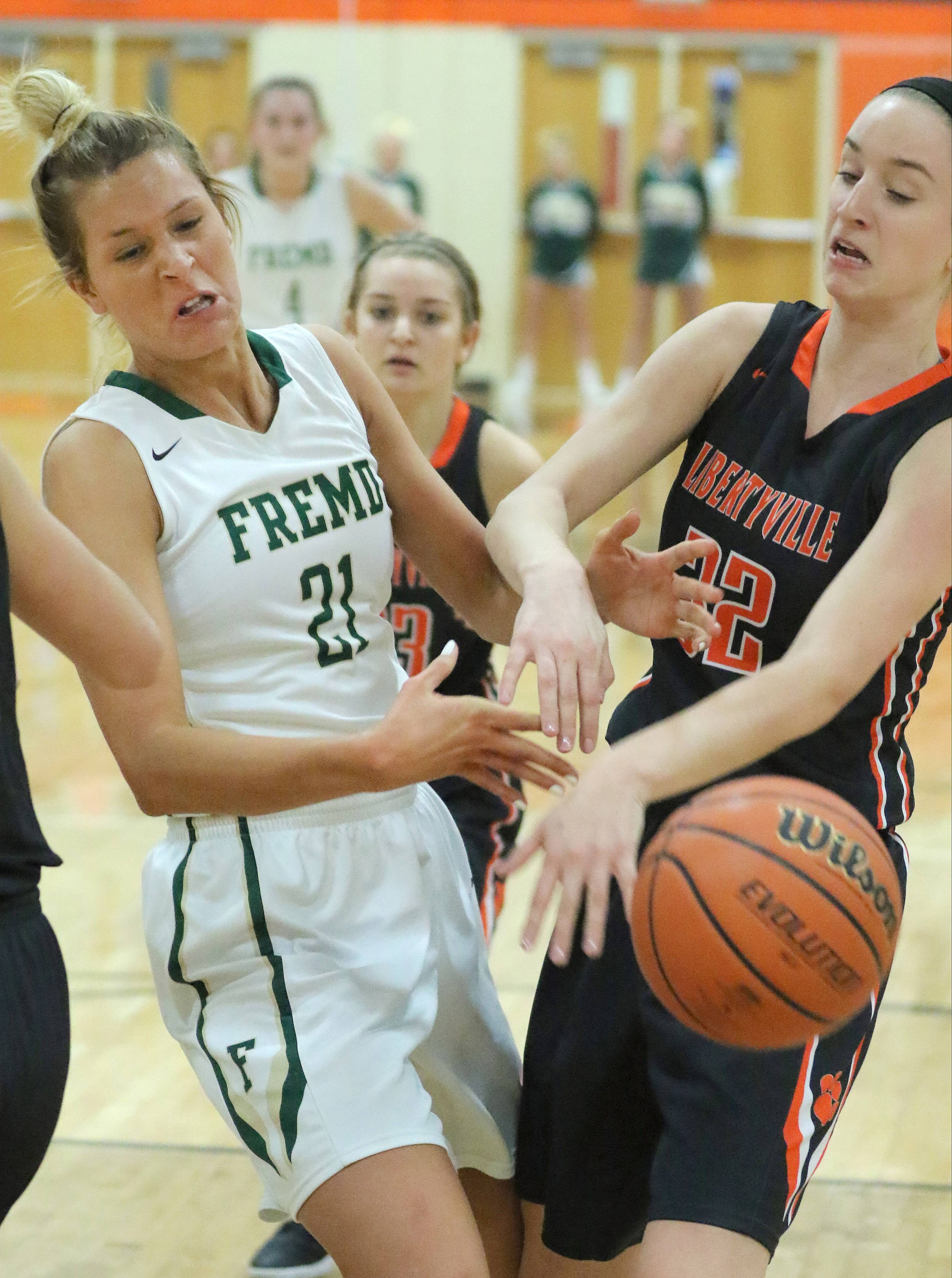 Fremd's Grace Tworek, left, and Libertyville's Caroline Frea battle for a rebound during Class 4A sectional semifinal play Monday at Libertyville.