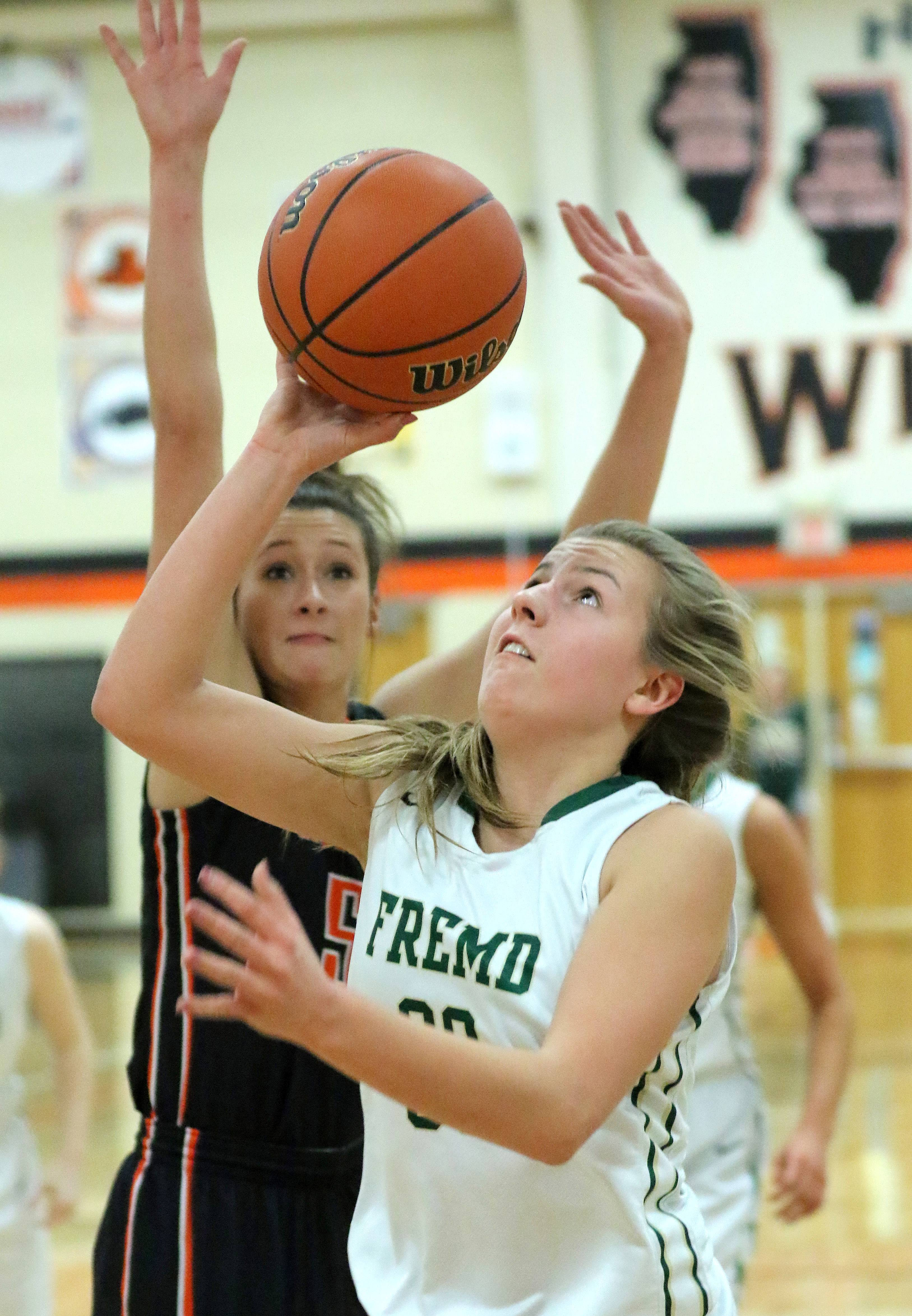 Fremd's Emily Klaczek, right, drives past Libertyville's Claire Keefe during Class 4A sectional semifinal play Monday at Libertyville.