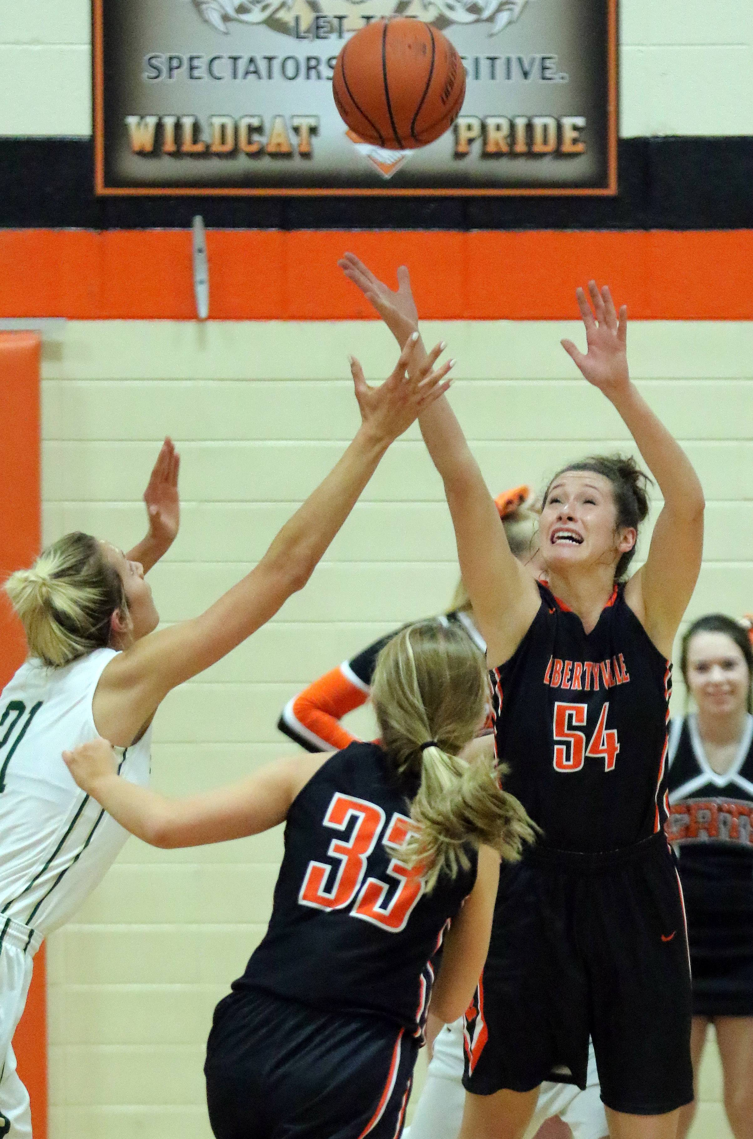 Libertyville's Claire Keefe, right, and Fremd's Grace Tworek battle for a rebound during Class 4A sectional semifinal play Monday at Libertyville.