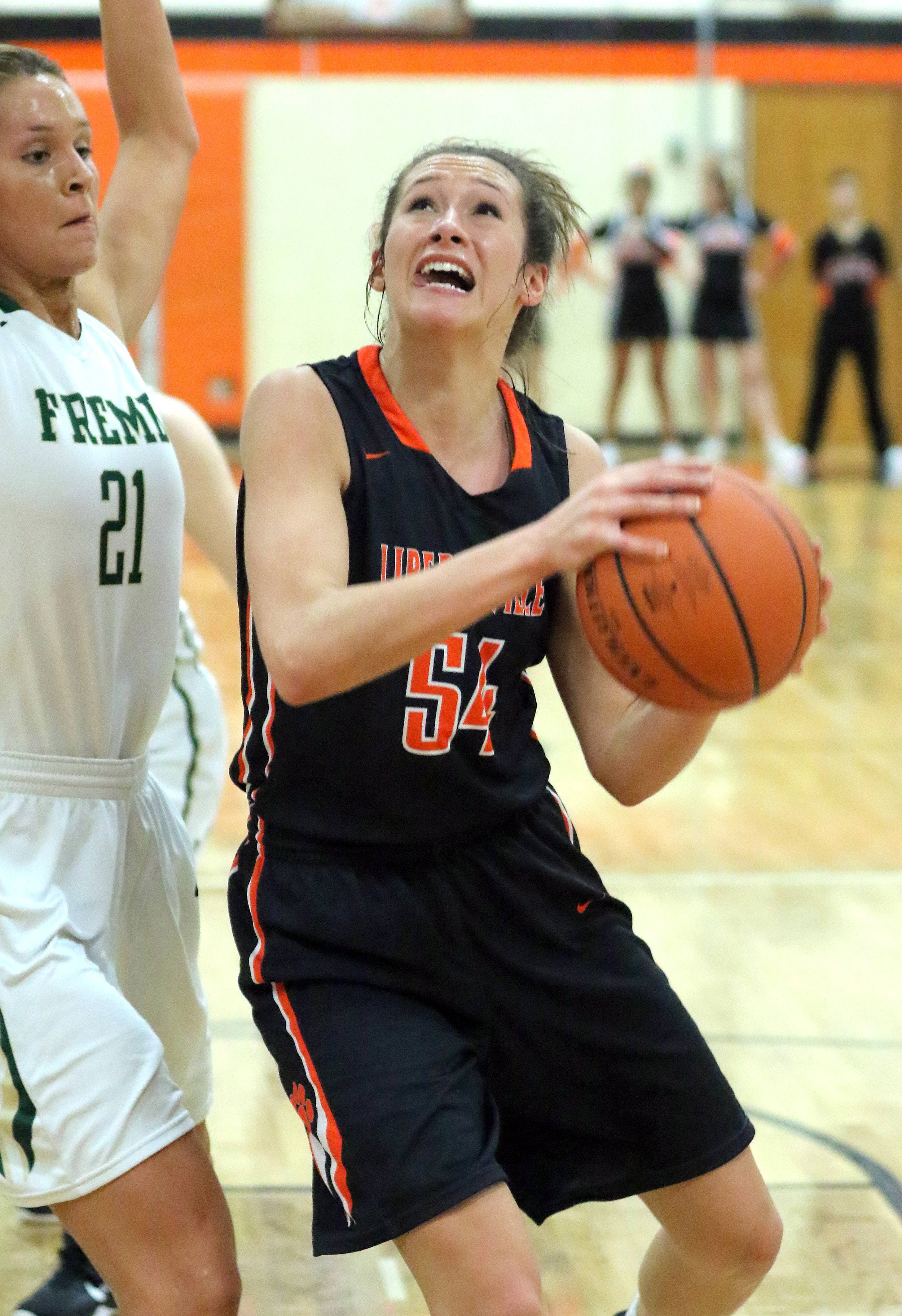 Libertyville's Claire Keefe, right, drives on Fremd's Grace Tworek during Class 4A sectional semifinal play Monday at Libertyville.
