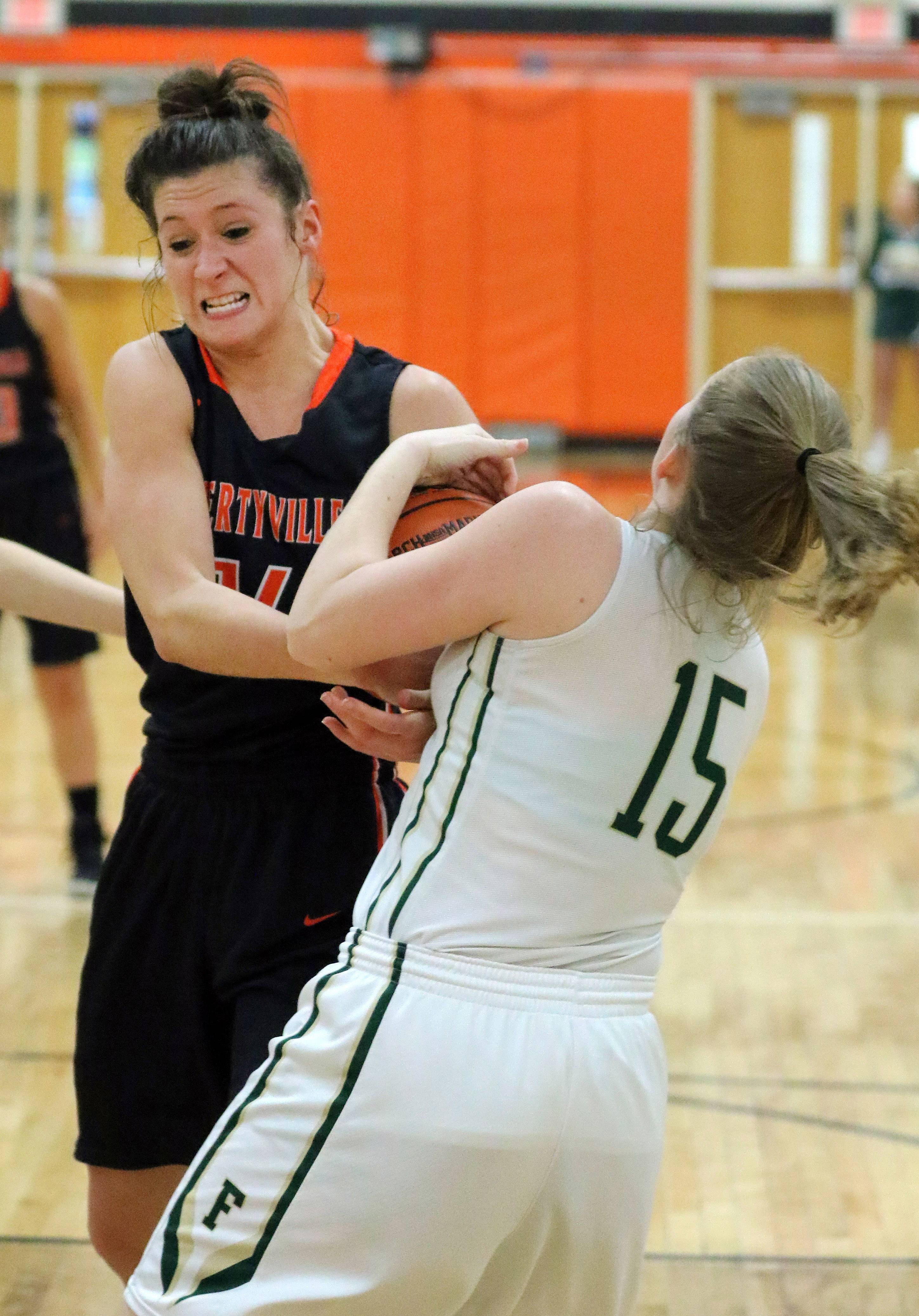 Libertyville's Claire Keefe, left, and Fremd's Colleen Kennedy battle for a rebound during Class 4A sectional semifinal play Monday at Libertyville.
