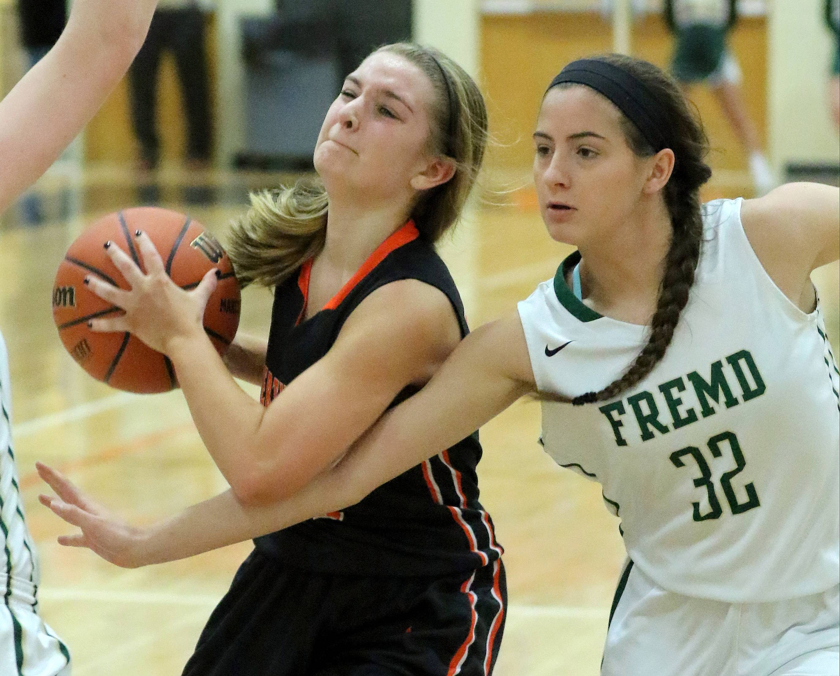 Libertyville's Morgan Manski, left, drives on Fremd's Angie Zara during Class 4A sectional semifinal play Monday at Libertyville.