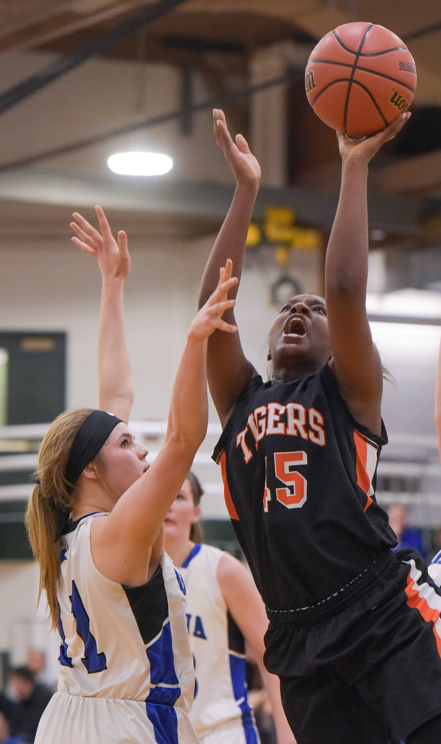 Wheaton Warrenville South's Jayla Johnson takes a shot over Geneva's Maddy Yelle during the Class 4A sectional semifinal girls basketball Monday at Glenbard West.