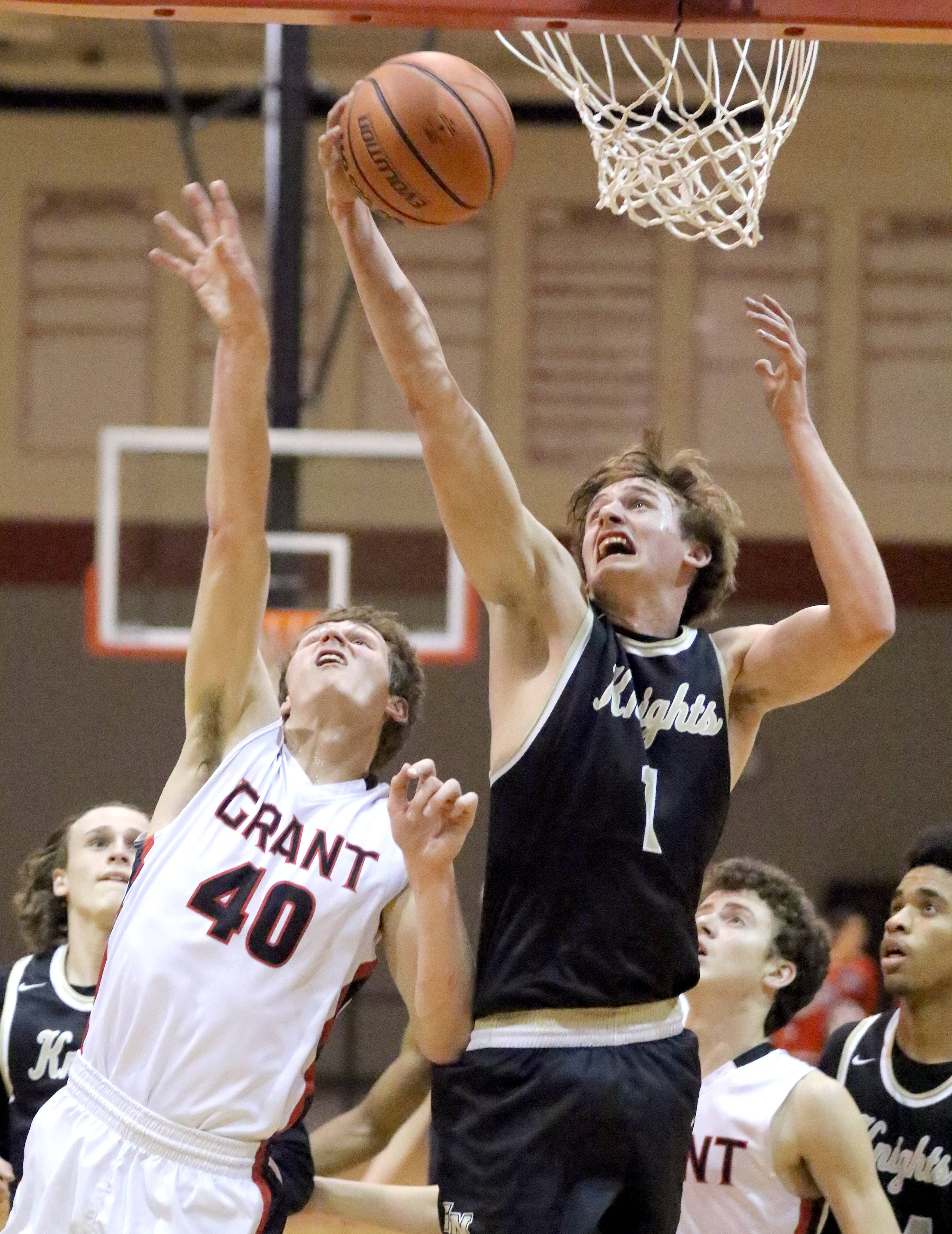 Grayslake North's James Connolly, right, pulls down a rebound over Grant's Andy Kaye on Tuesday at Grant.