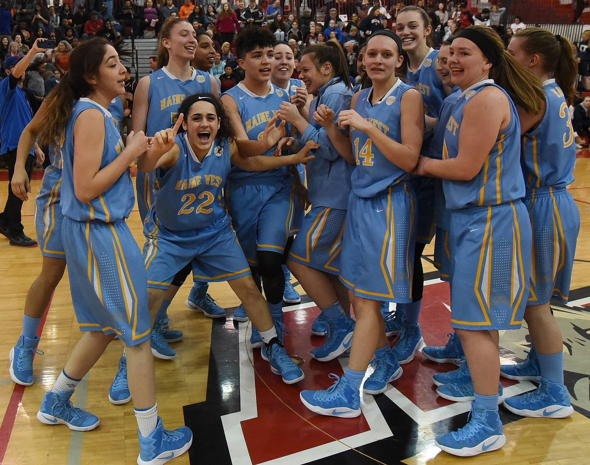 Maine West celebrates after defeating Evanston in the Class 4A sectional final at Niles West on Thursday night.