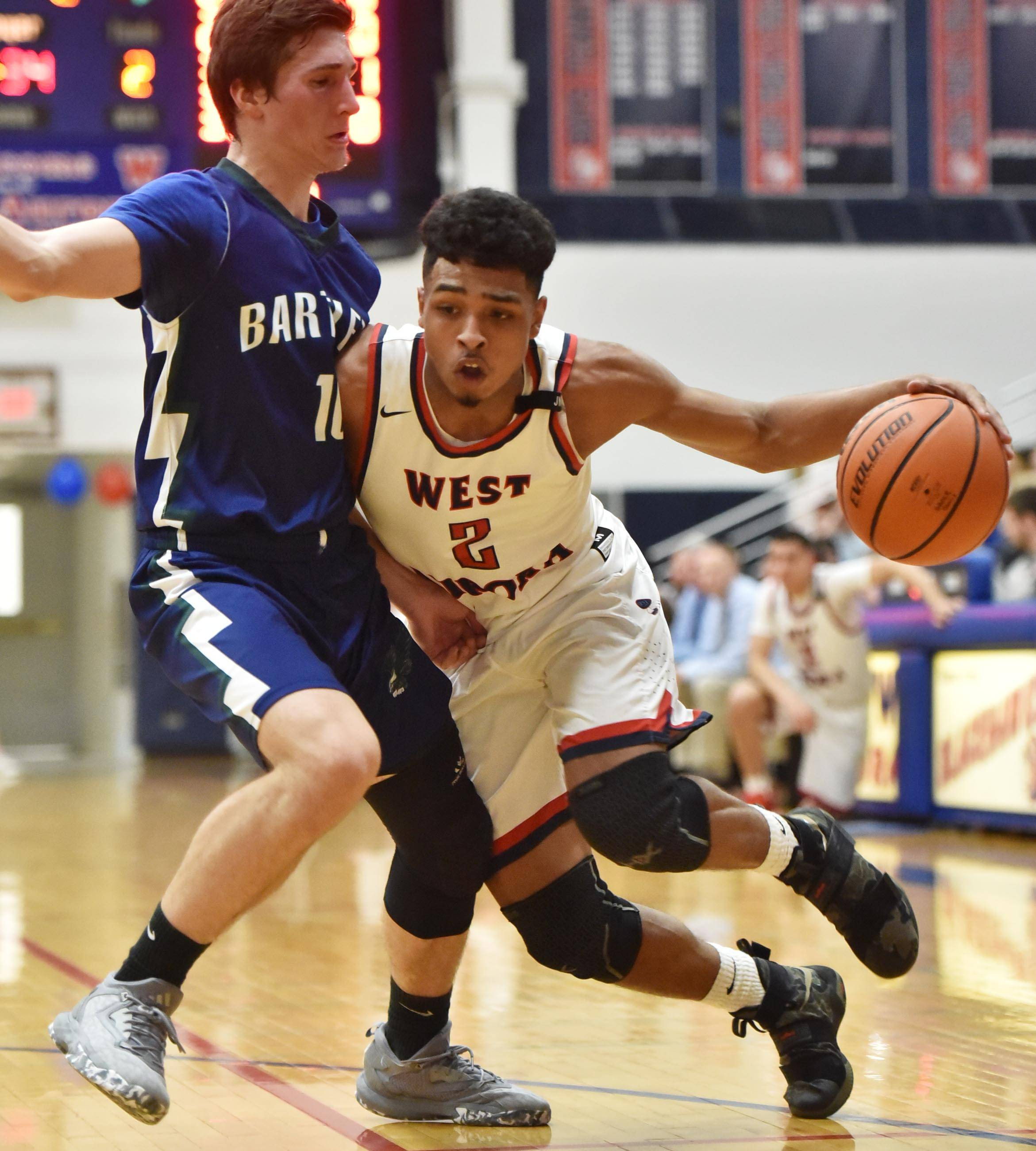 Bartlett's Tomas Vikonis, pictured guarding West Aurora's Camron Donatlan Wednesday in Aurora, and his Hawks teammates are part of an extremely competitive field at the Class 4A Larkin regional. West Aurora earned the No. 5 seed in the Lincoln-Way East sectional.