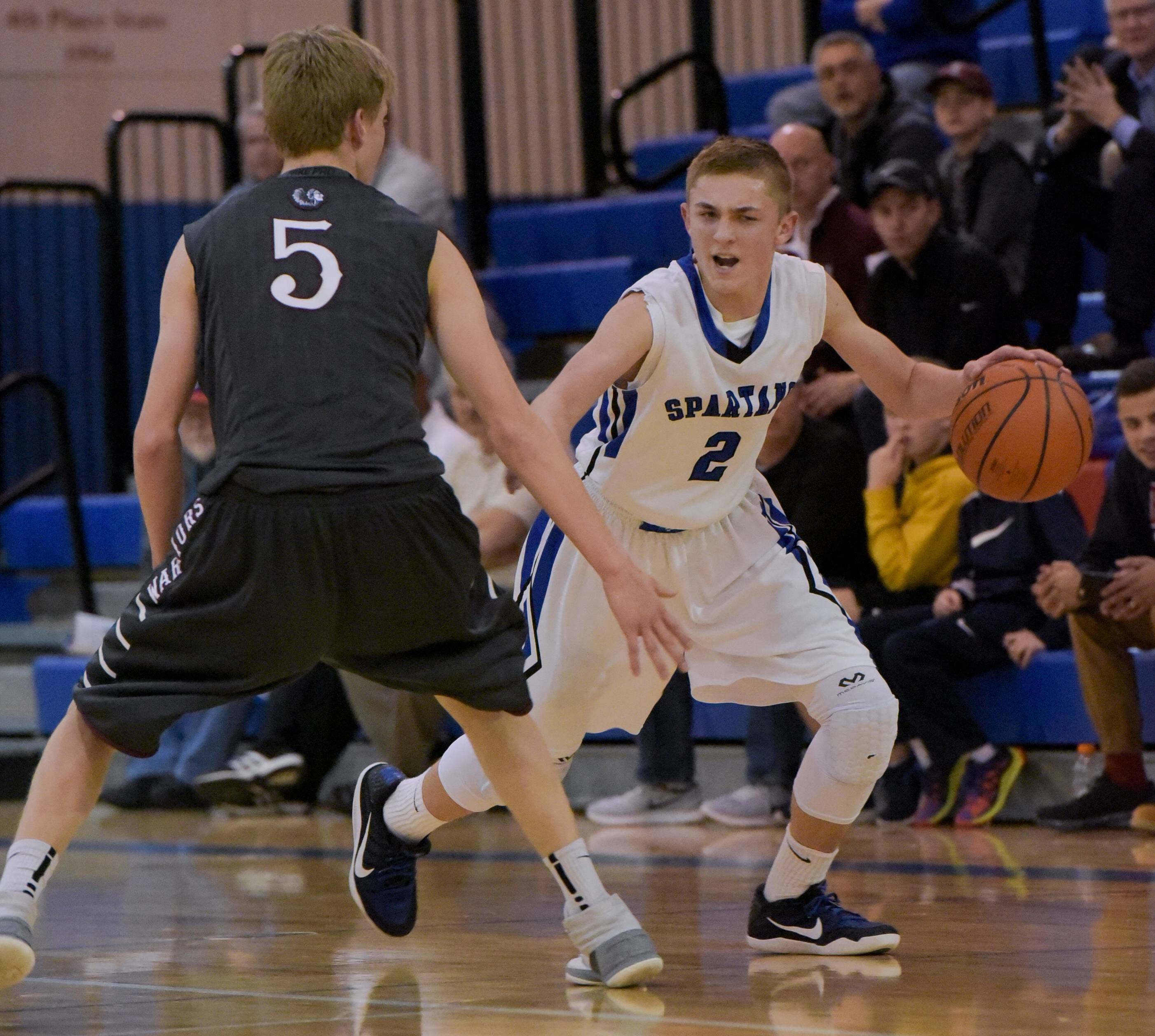St. Francis' Matthew Cooney looks to move around Wheaton Academy's Marcus Bult during the Class 3A regional boys basketball game Monday at Marmion Academy.