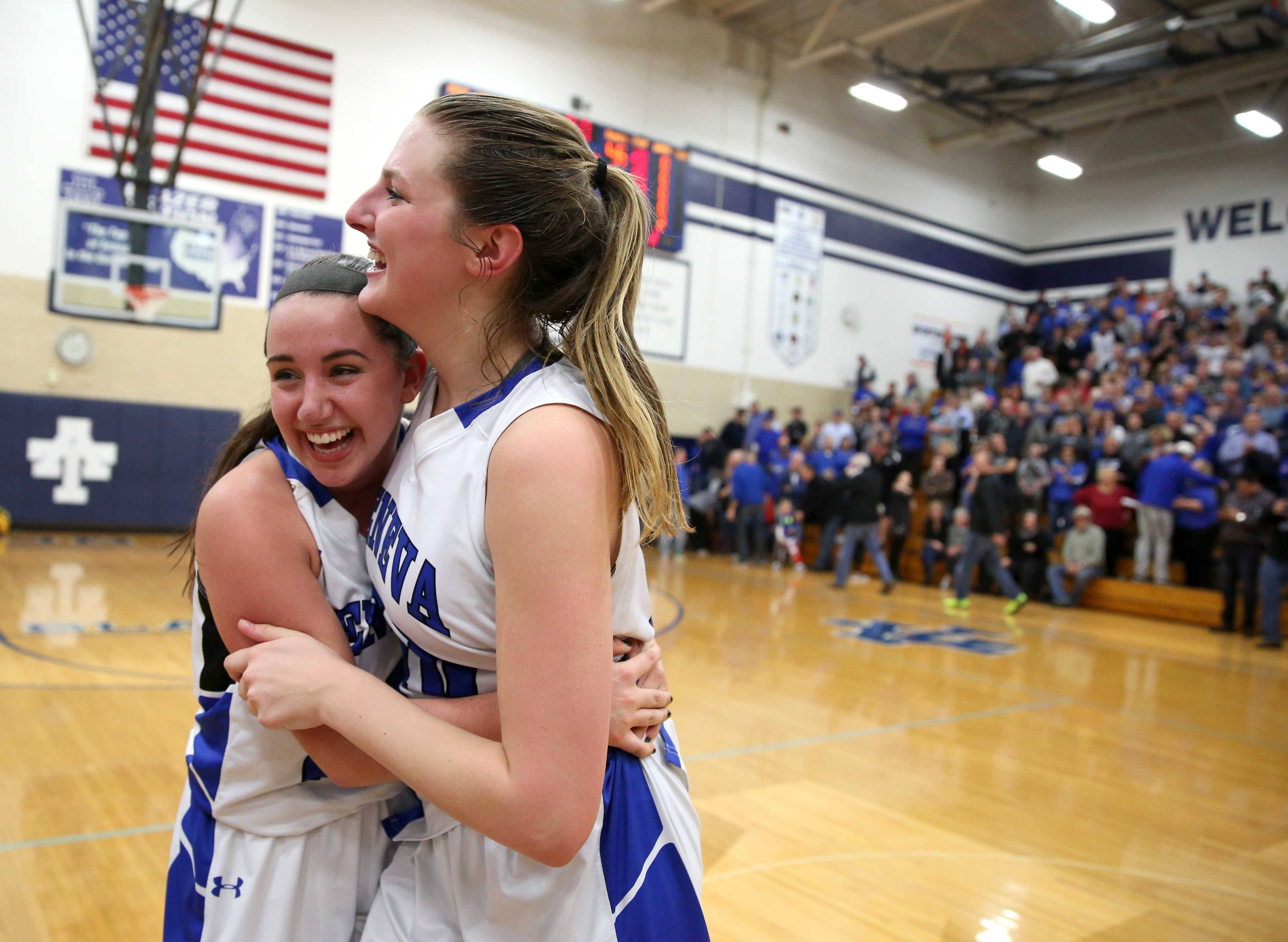 Geneva's Margaret Whitley, left, and Grace Loberg embrace after a win over Maine West during girls basketball supersectional action at Addison Trail High School Monday night.