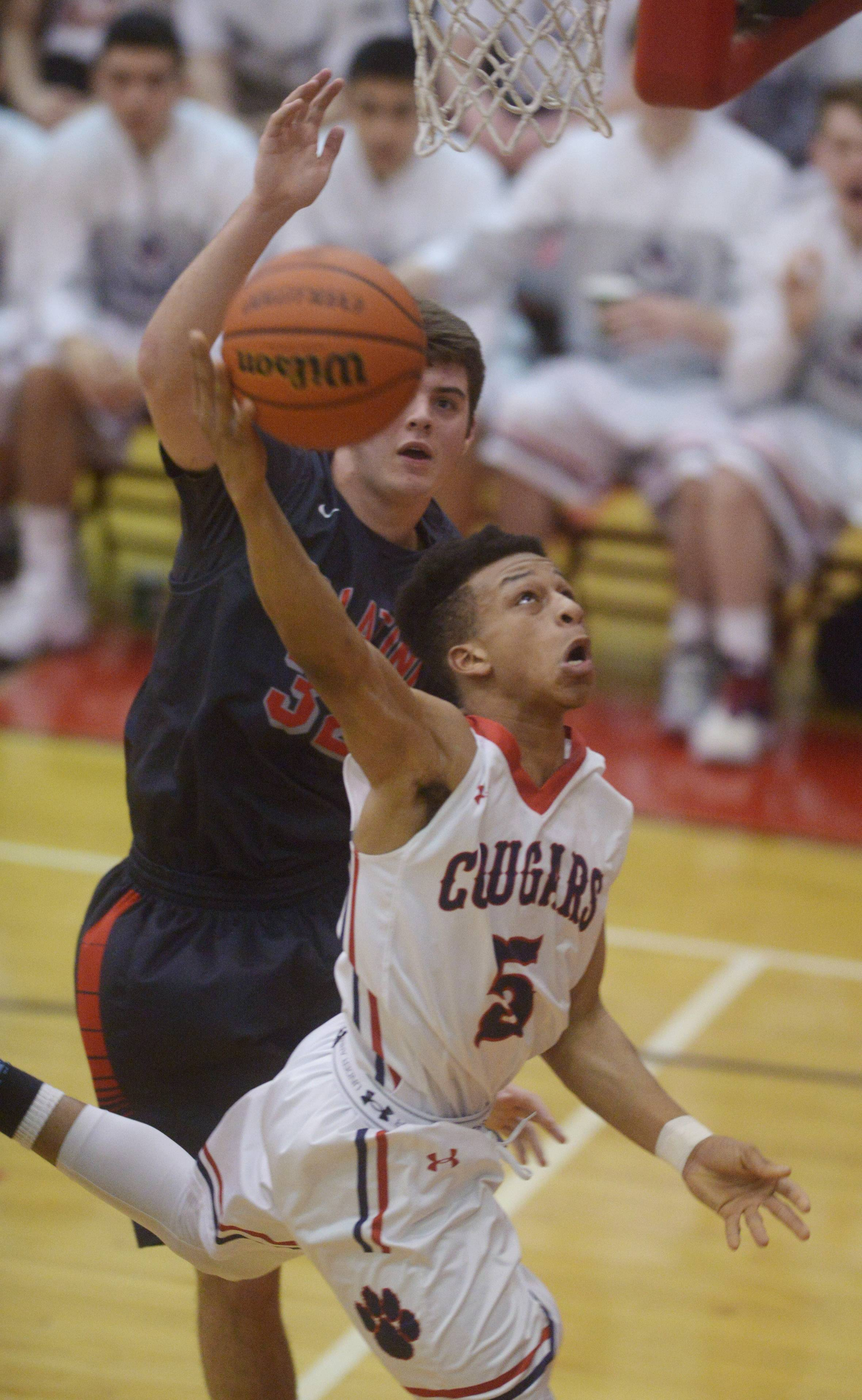 Conant's C.J. Deshazer drives to the basket in front of Palatine's Scott Elter during the Class 4A regional semifinal at Palatine on Tuesday.