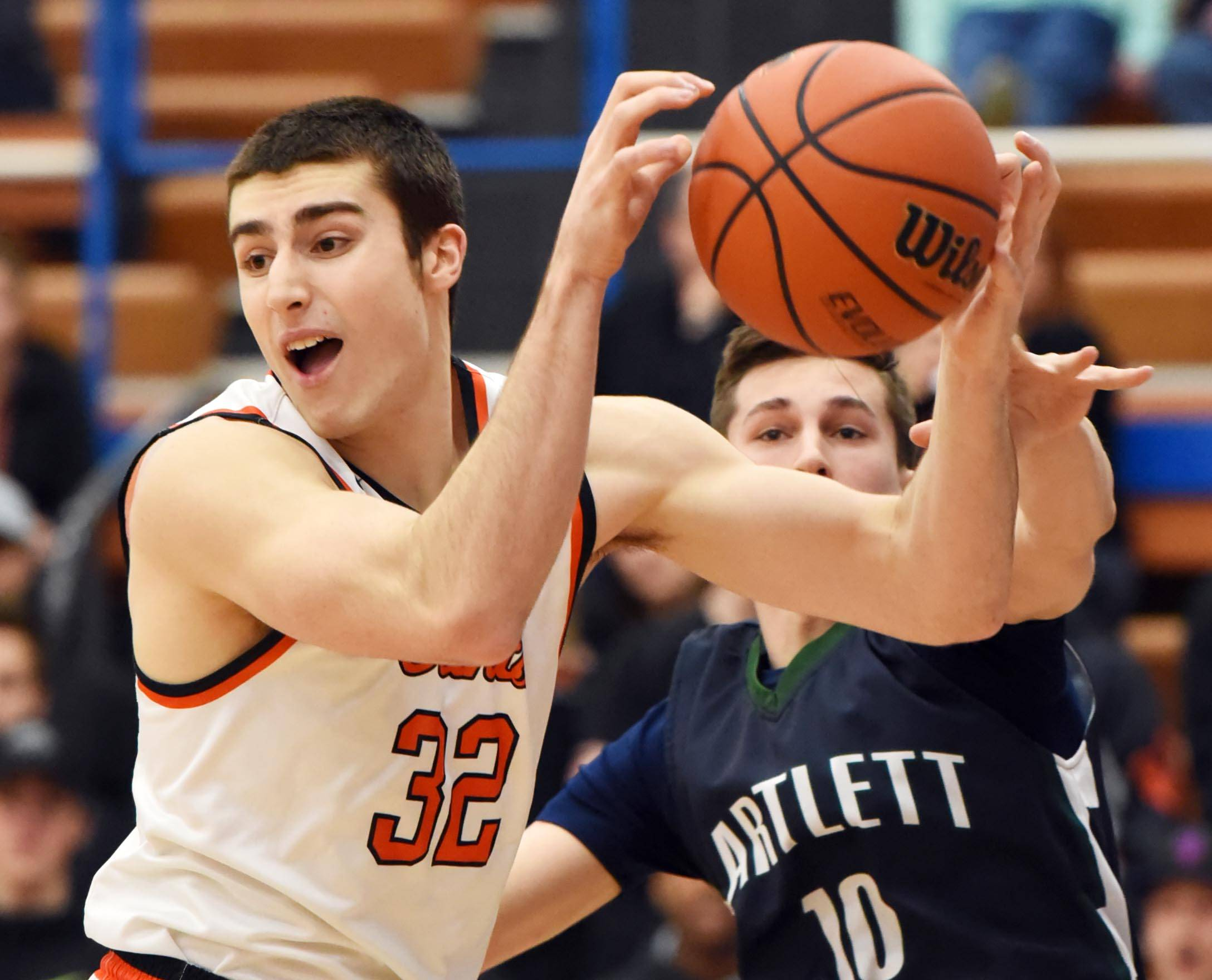 St. Charles East's Justin Hardy loses his grip on the ball as Bartlett's TomasVikonis reaches for it Wednesday at the boys basketball regional tournament game in Elgin.