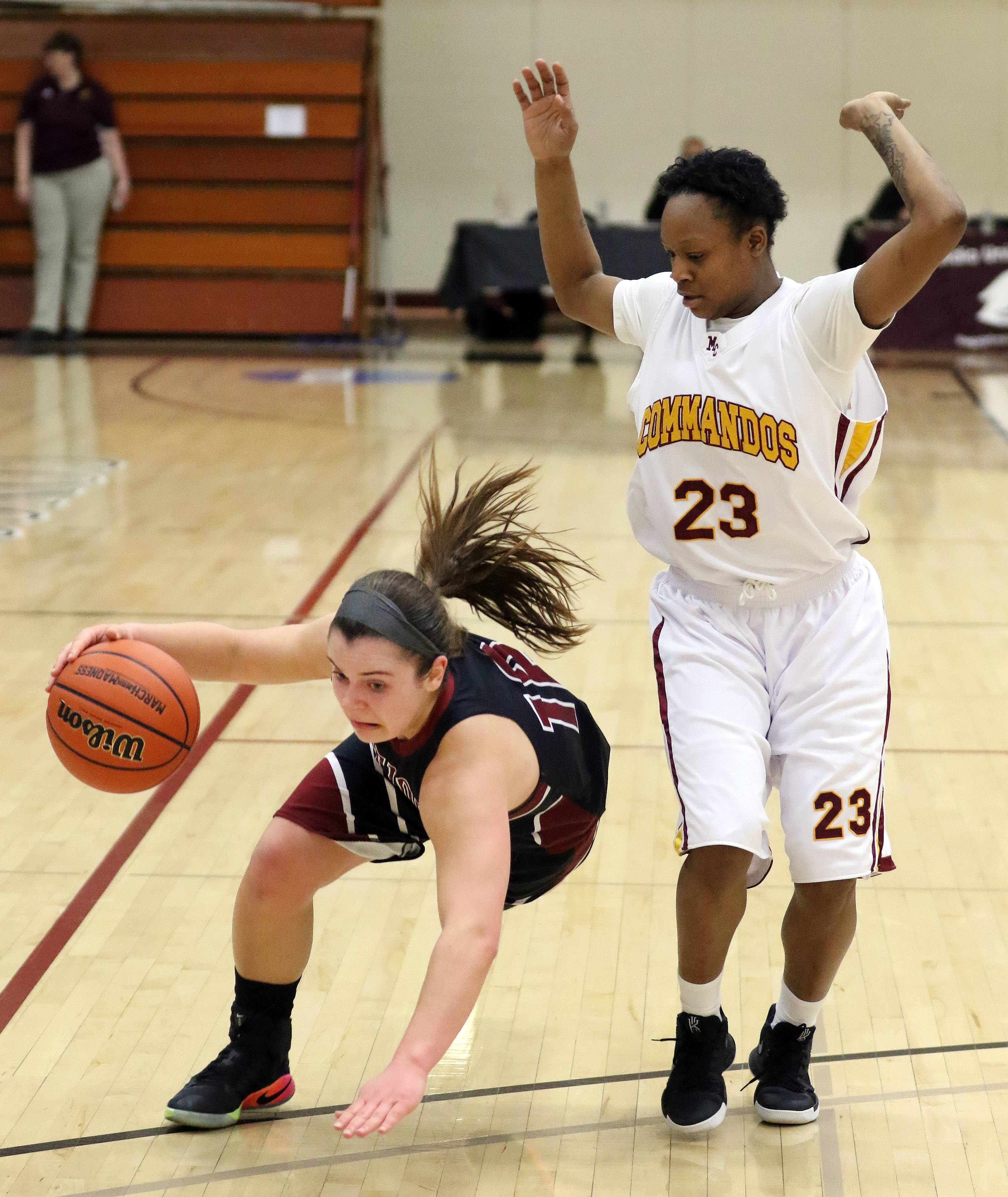 Antioch's Ashley Reiser, left, gets tripped up by Marshall's Temya Russell during the Class 3A supersectional at Concordia University in River Forest on Monday.