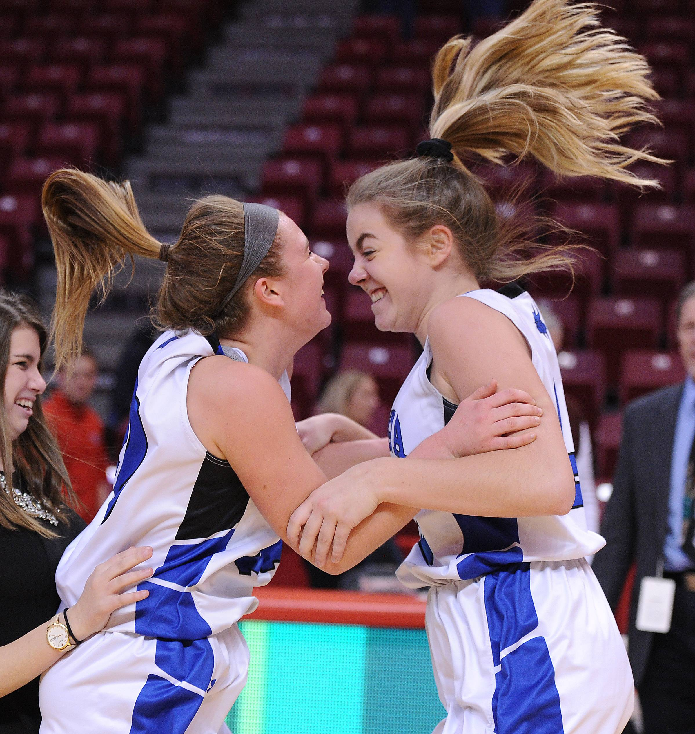 Geneva's Briana Borkowicz and Stephanie Hart celebrate their 34-33 victory over Fremd in the Class 4A girls basketball state semifinals in Normal on Friday.
