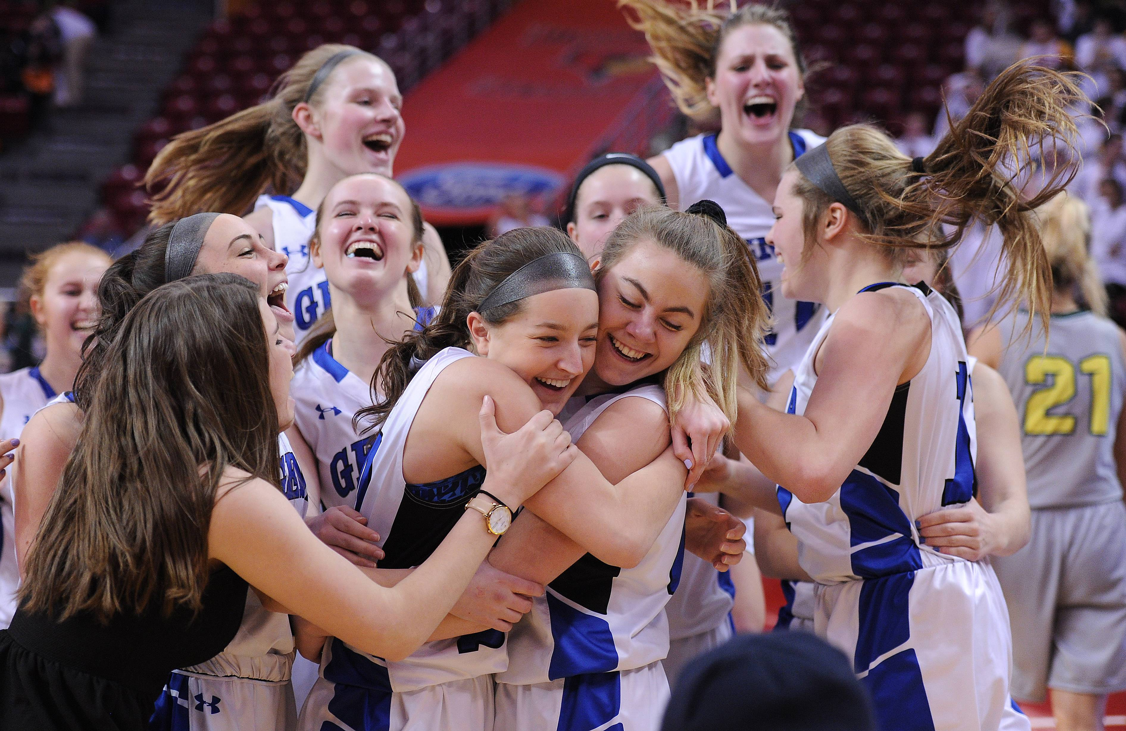 Geneva celebrate its 34-33 victory over Fremd in the Class 4A girls basketball state semifinals in Normal on Friday.