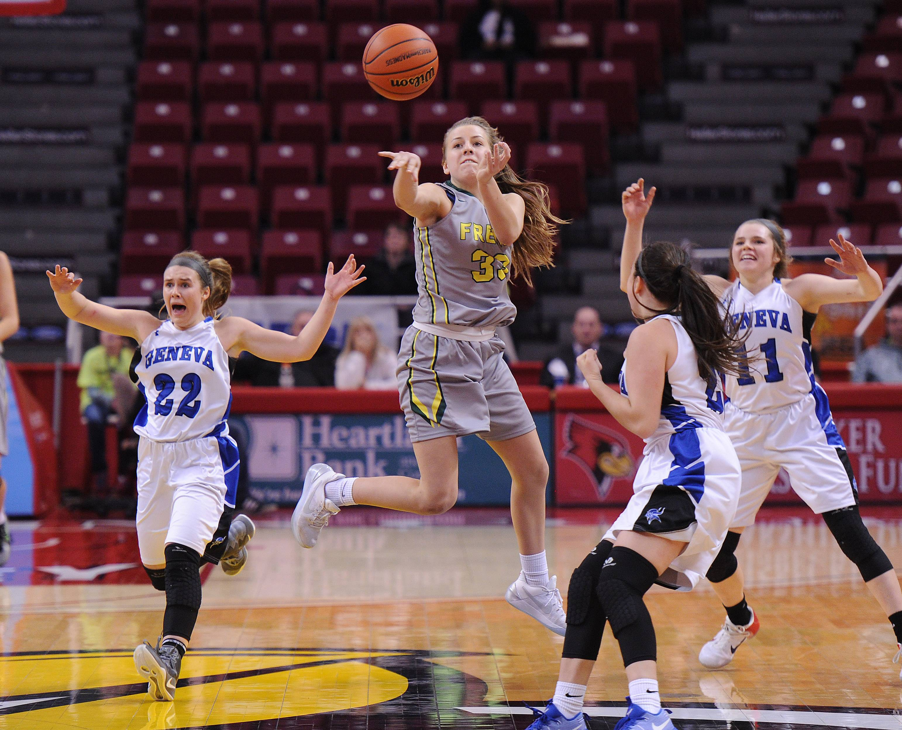 Fremd's Emily Klaczek throws up one more shot at the buzzer but it's no good as Geneva's Briana Borkowicz starts the celebration in the Class 4A girls basketball state semifinals in Normal on Friday.