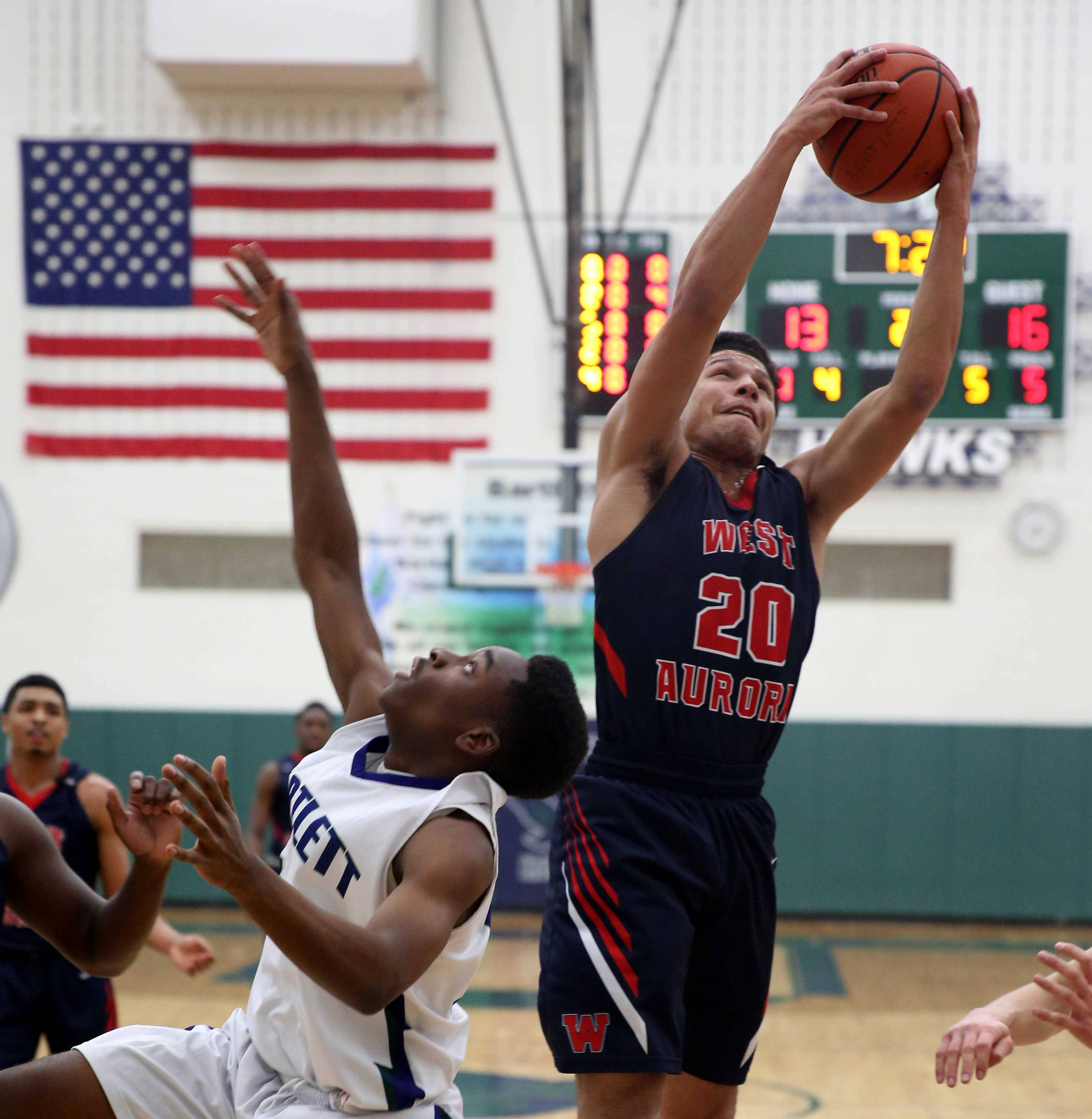 West Aurora's Caleb Siler (20) grabs a rebound against Bartlett earlier this season. West Aurora tackles No. 1 Bolingbrook Tuesday in one semifinal of the Class 4A Lincoln-Way East sectional.