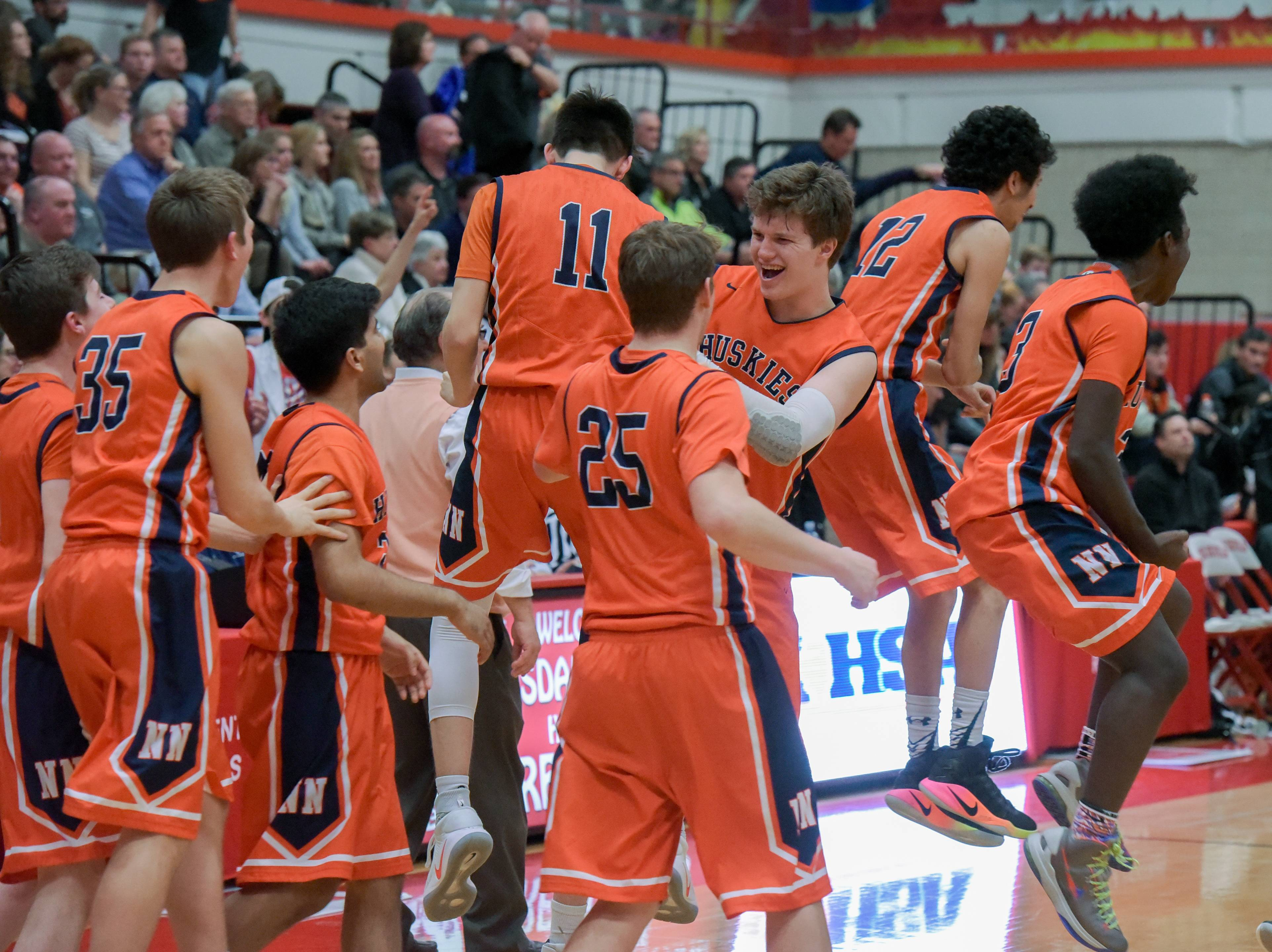 Naperville North celebrate defeating Wheaton Warrenville South 40-35 Tuesday during the Hinsdale Central sectional semifinal.