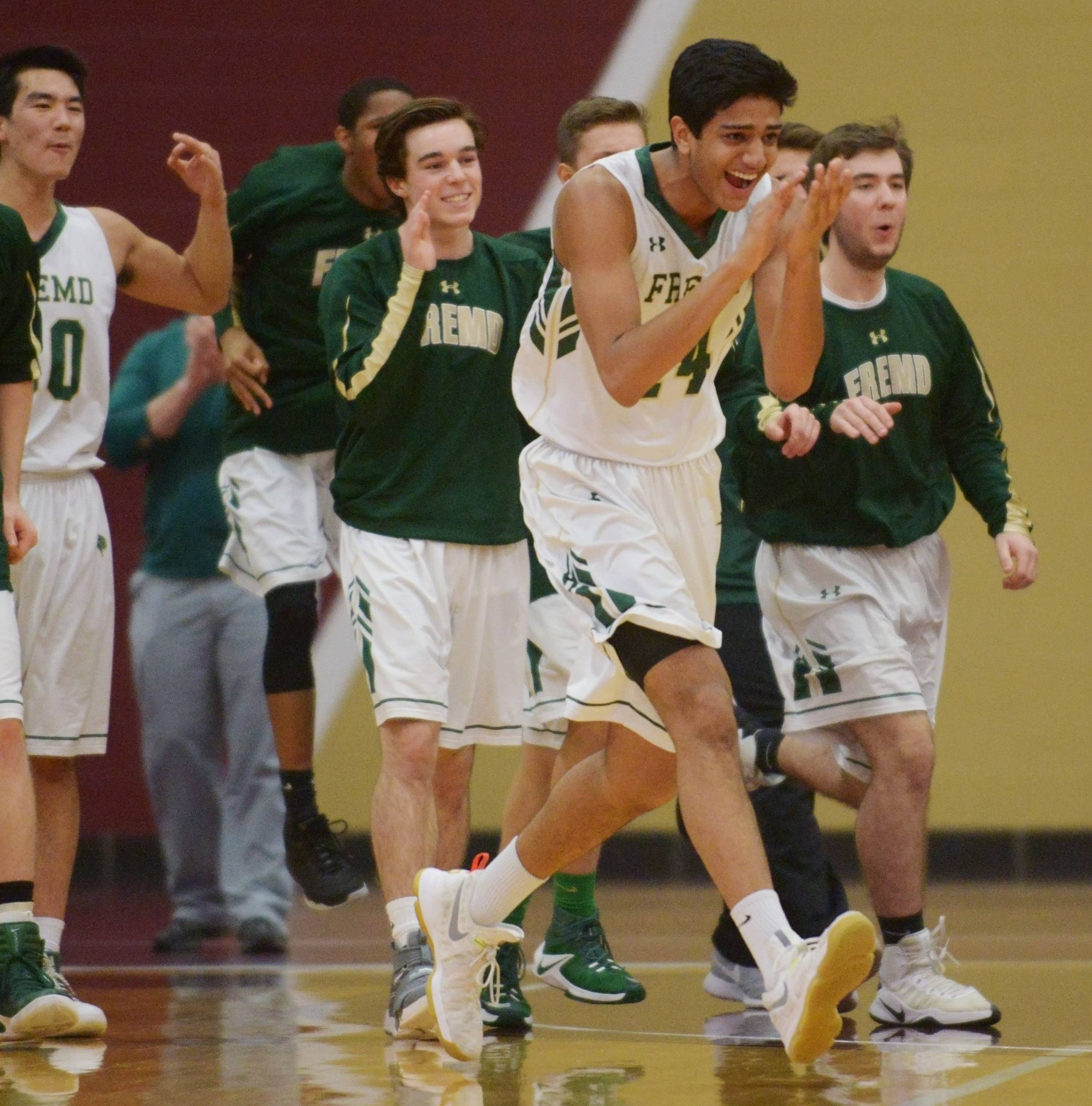 Fremd players including Shaan Patel, front, react as the first quarter ends with a buzzer-beater during the Class 4A sectional semifinal against Grant at the Robert Morris University gymnasium in Arlington Heights on Tuesday.