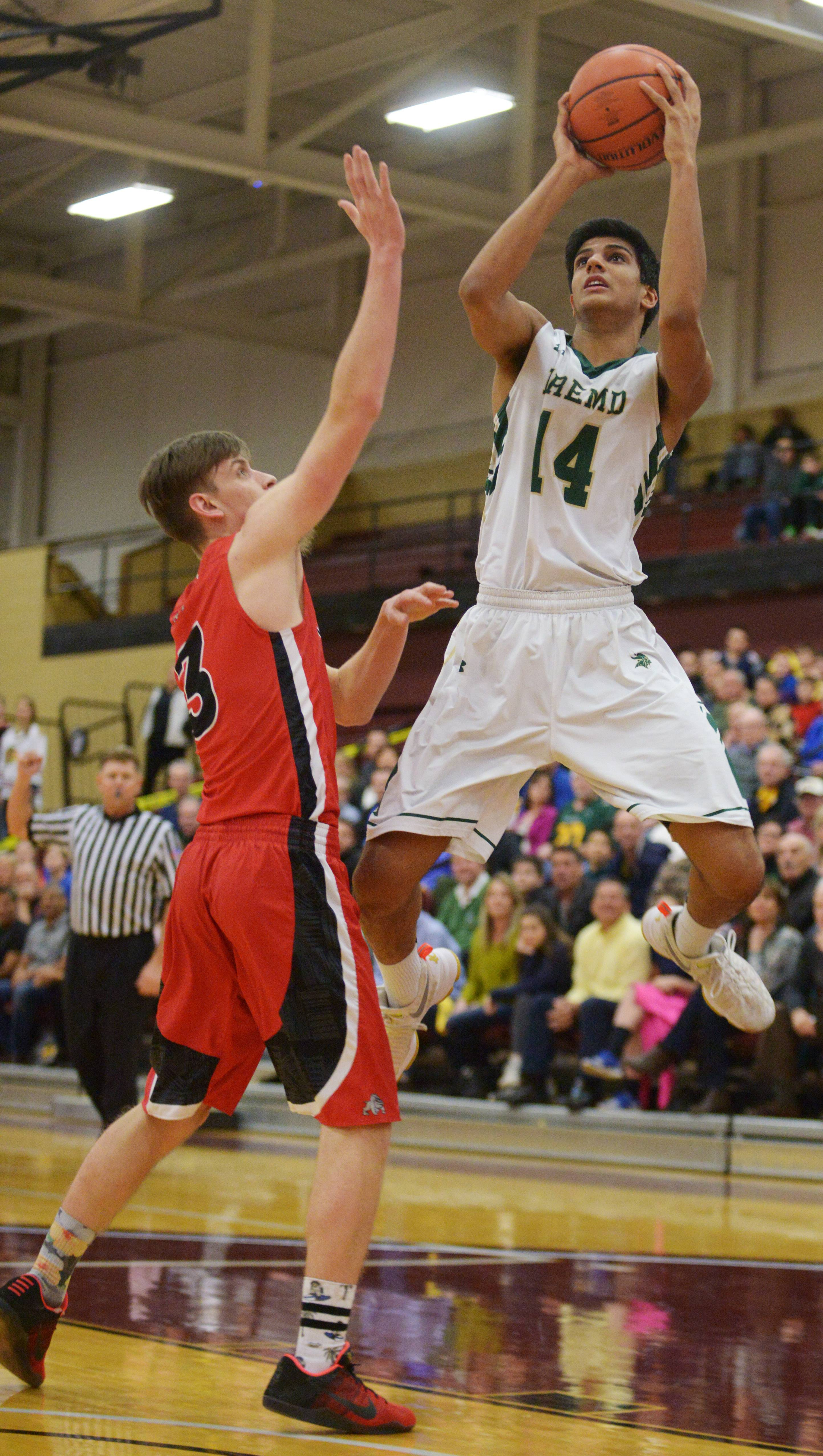 Fremd's Shaan Patel shoots as Grant's Mike Huff defends during the Elk Grove sectional semifinal played at the Robert Morris University gymnasium in Arlington Heights on Tuesday.