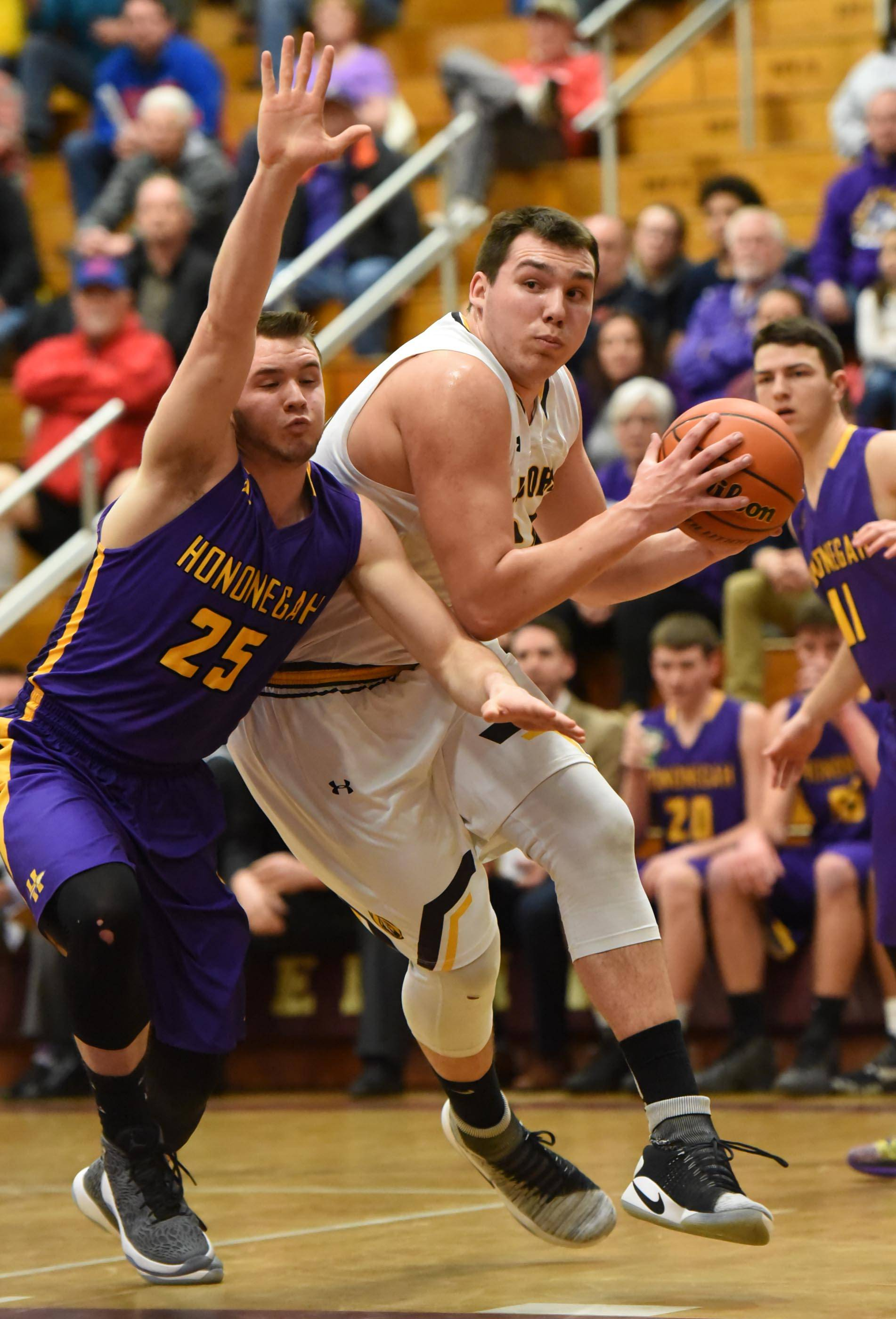 Jacobs' Cameron Krutwig drives around Hononegah's Jackson Doyle Wednesday in the Class 4A Elgin sectional semifinal game. The Golden Eagles beat Hononegah 60-55 and will take on Larkin Friday at 7 p.m. for the sectional title.