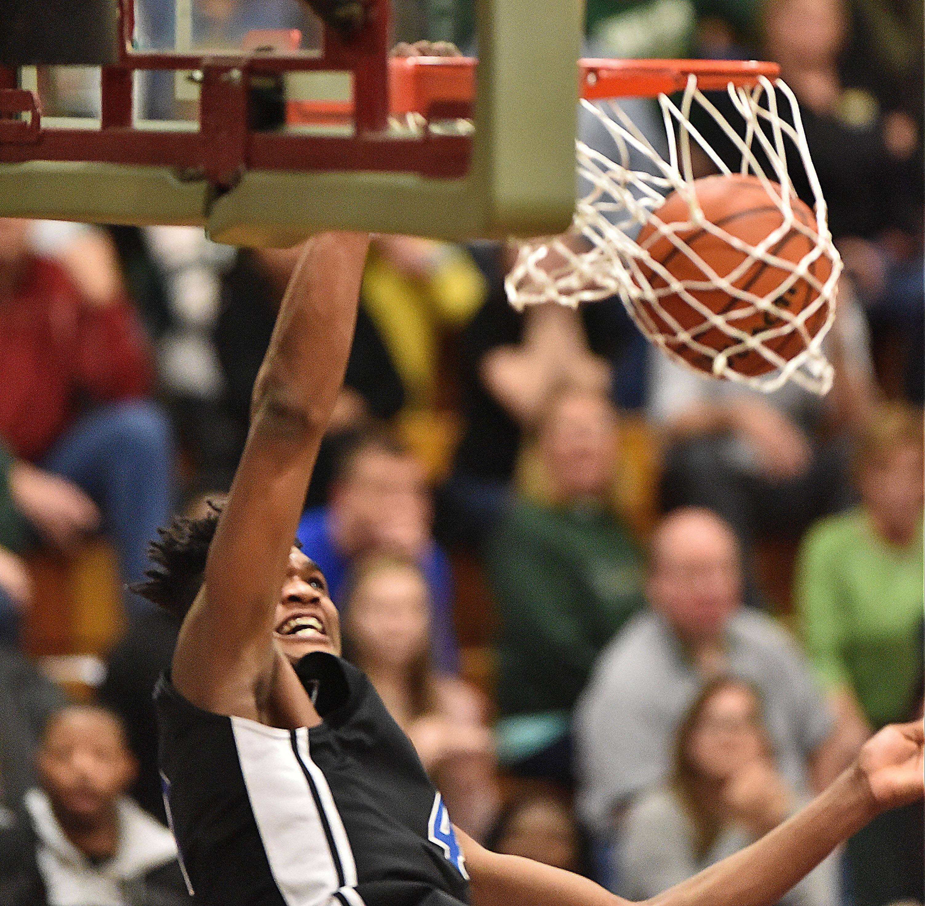 Larkin junior Jalen Shaw finishes off a dunk against Rockford Boylan during the Royals' 62-51 Class 4A Elgin sectional semifinal win Tuesday night. Larkin battles Jacobs at 7 p.m. Friday for the sectional title.