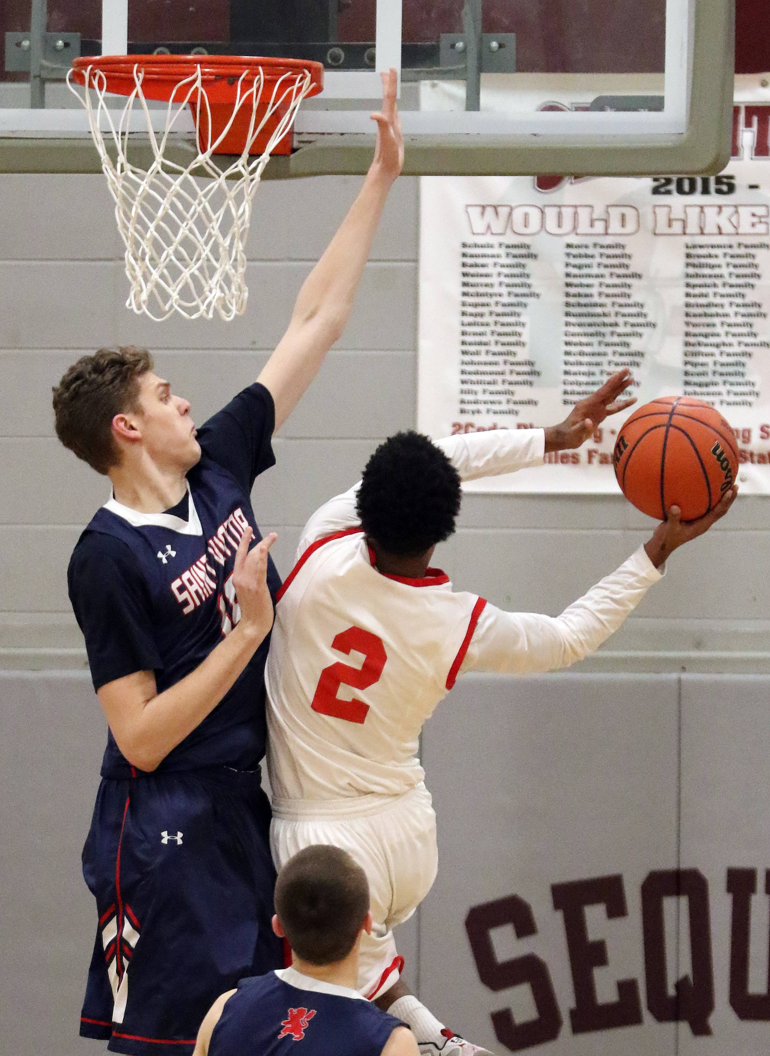 St. Viator's Addison Lubert, left, defends against North Chicago's Ishaun Walker in the Class 3A sectional final at Antioch on Friday.