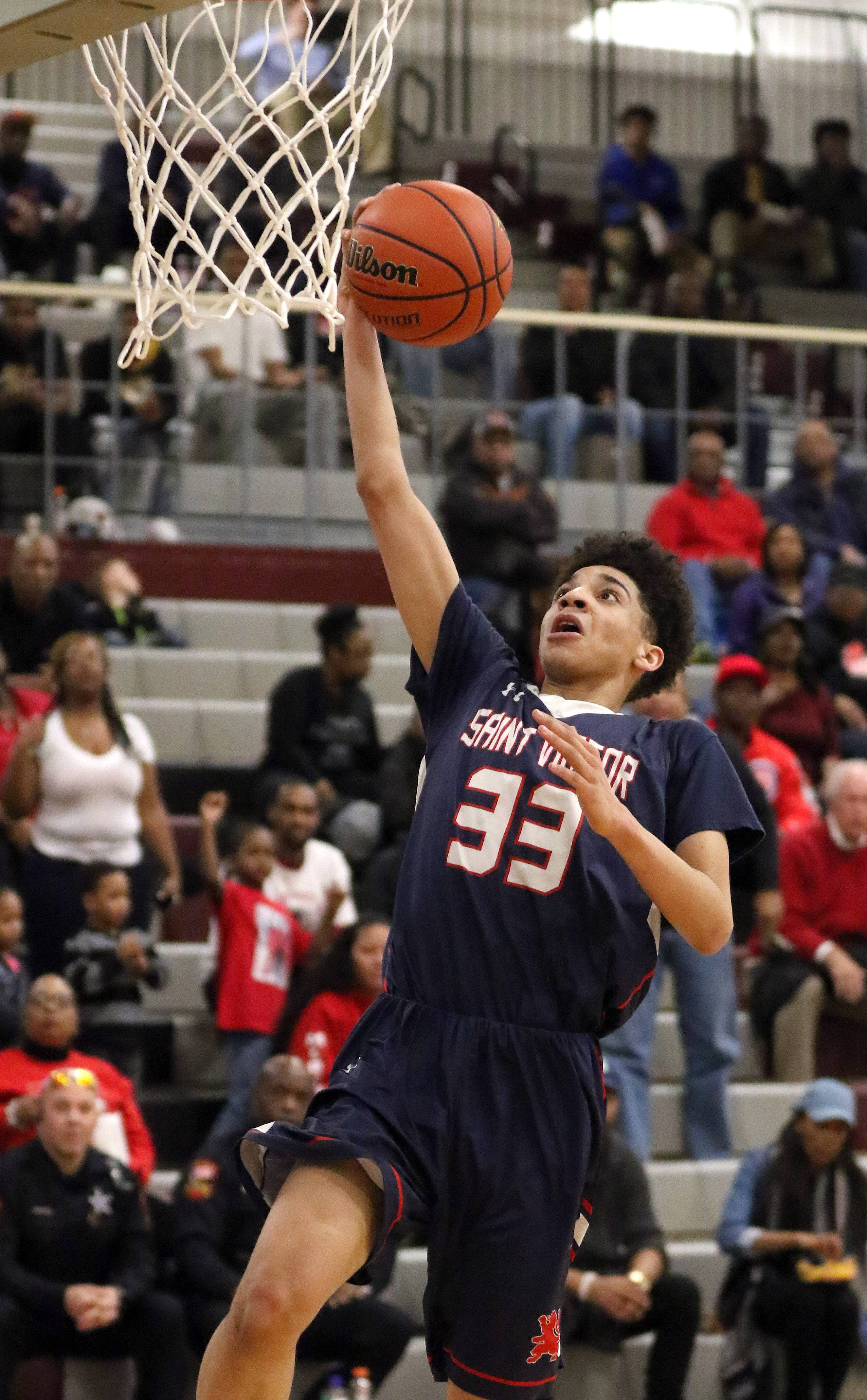St. Viator's Jeremiah Hernandez drives in for a layup in the Class 3A sectional final at Antioch on Friday.