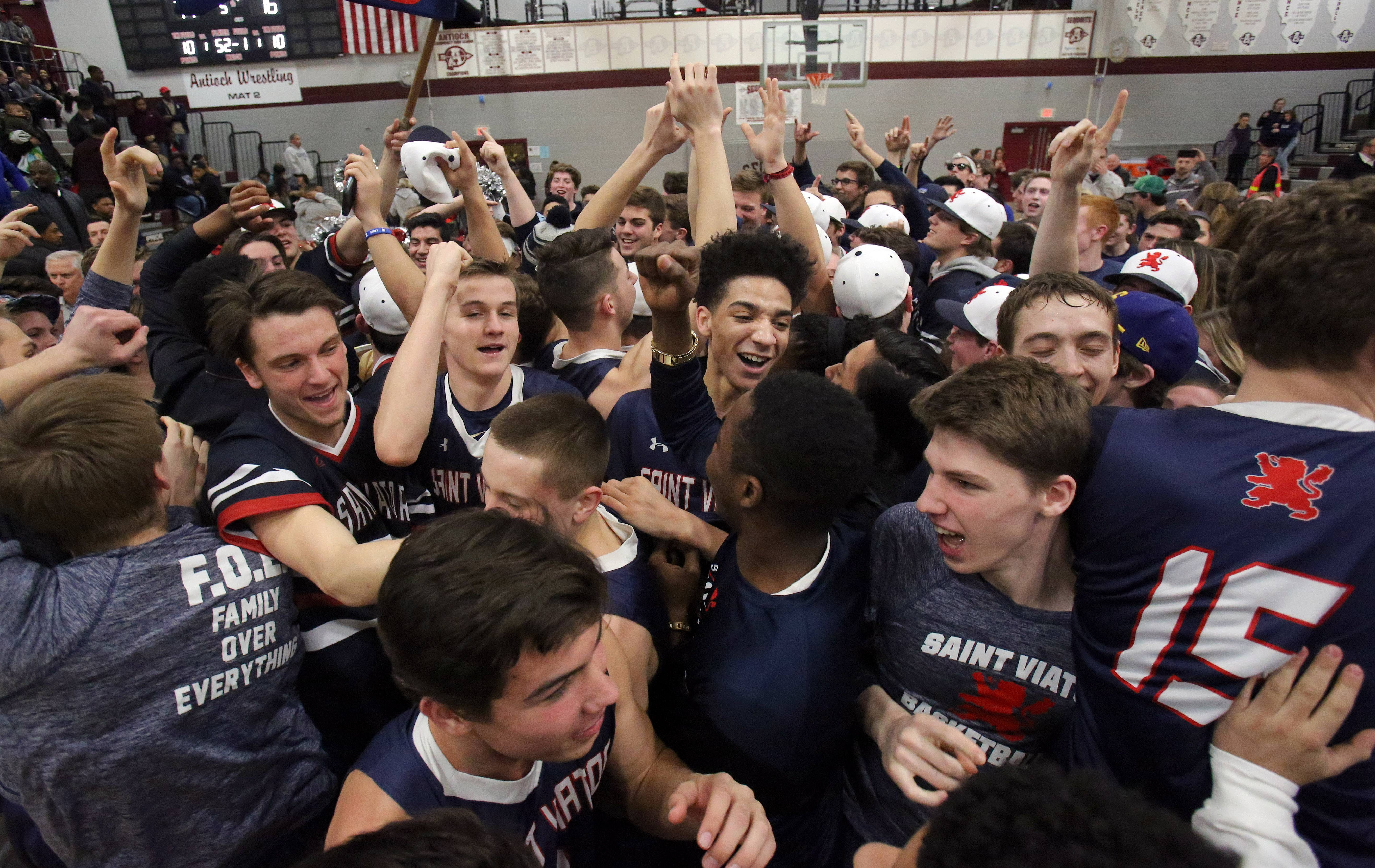 St. Viator players celebrate with their fans after their overtime win against North Chicago in the Class 3A sectional final at Antioch on Friday.