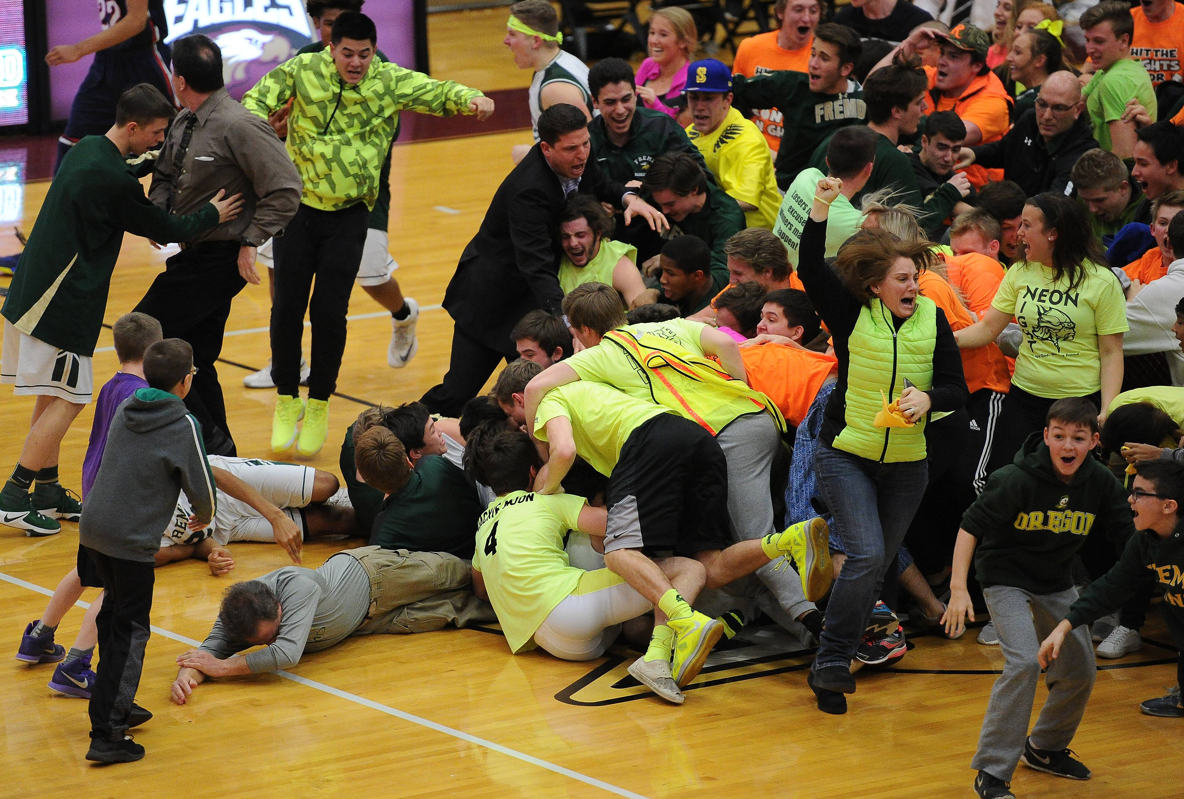 It's bedlam on the court at Robert Morris University following a buzzer-beating 3 from Fremd's Kyle Sliwa in a 43-42 victory over Conant in Class 4A sectional championshp play Friday.
