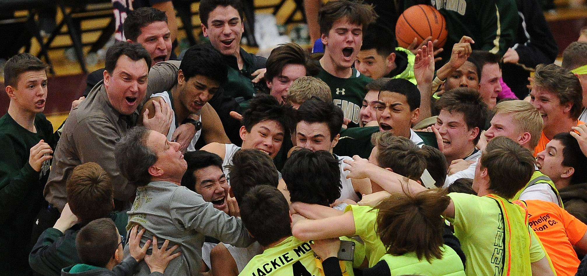 Fremd supporters swarm Kyle Sliwa after his clutch 3-pointer lifted the Vikings to a 43-42 win over Conant in the Class 4A sectional championship game Friday at Robert Morris University.