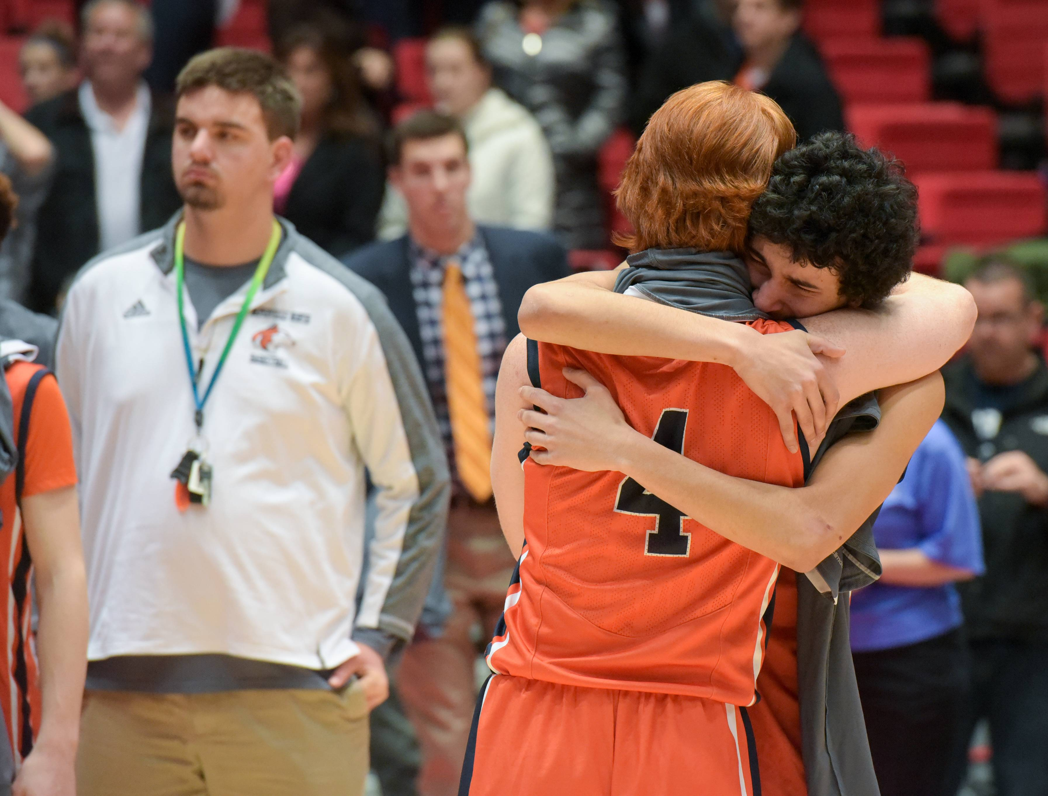 Naperville North's Scott Smith and Youcef Merabet console each other after the Huskies 83-57 loss to against the Bolingbrook during the Class 4A supersectional boys basketball game at Northern Illinois University on March 14, 2017.