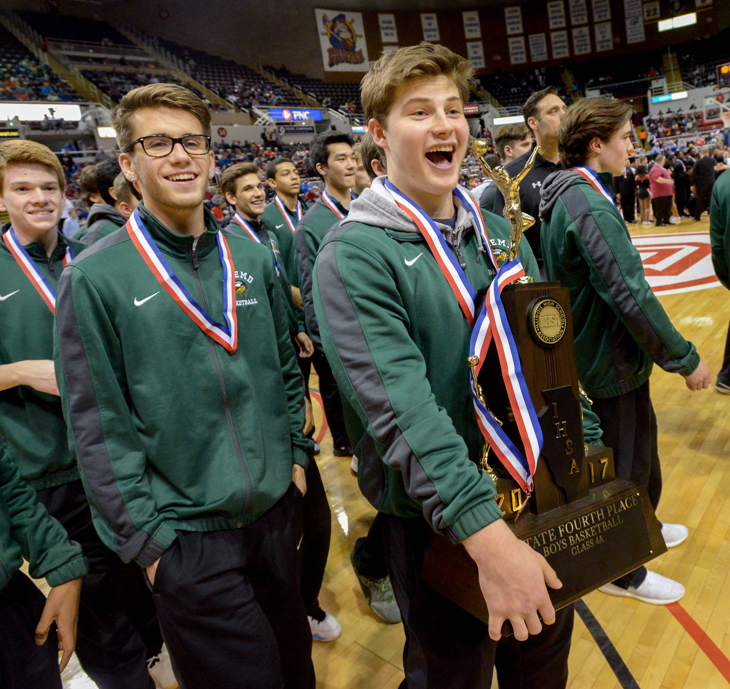 Fremd senior guard Luke Schoffstall holds the result of a 31-2 season which ended on a Saturday in Peoria: the state's Class 4A fourth-place trophy.