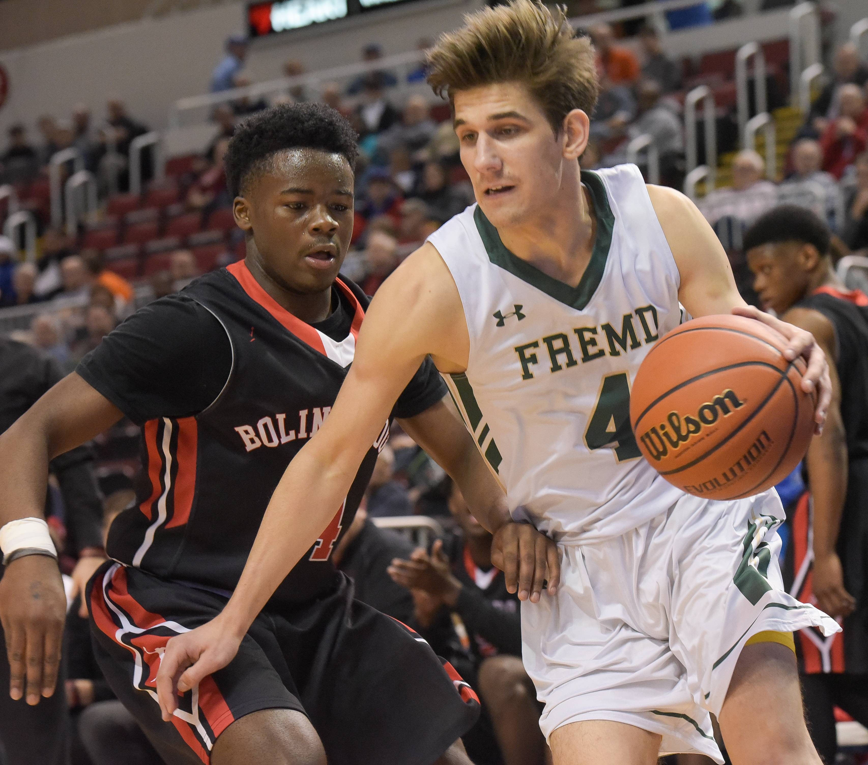 Fremd's Kyle Sliwa drives around Bolingbrook's Isaiah Clemmons during the Class 4A third-place game on Saturday.