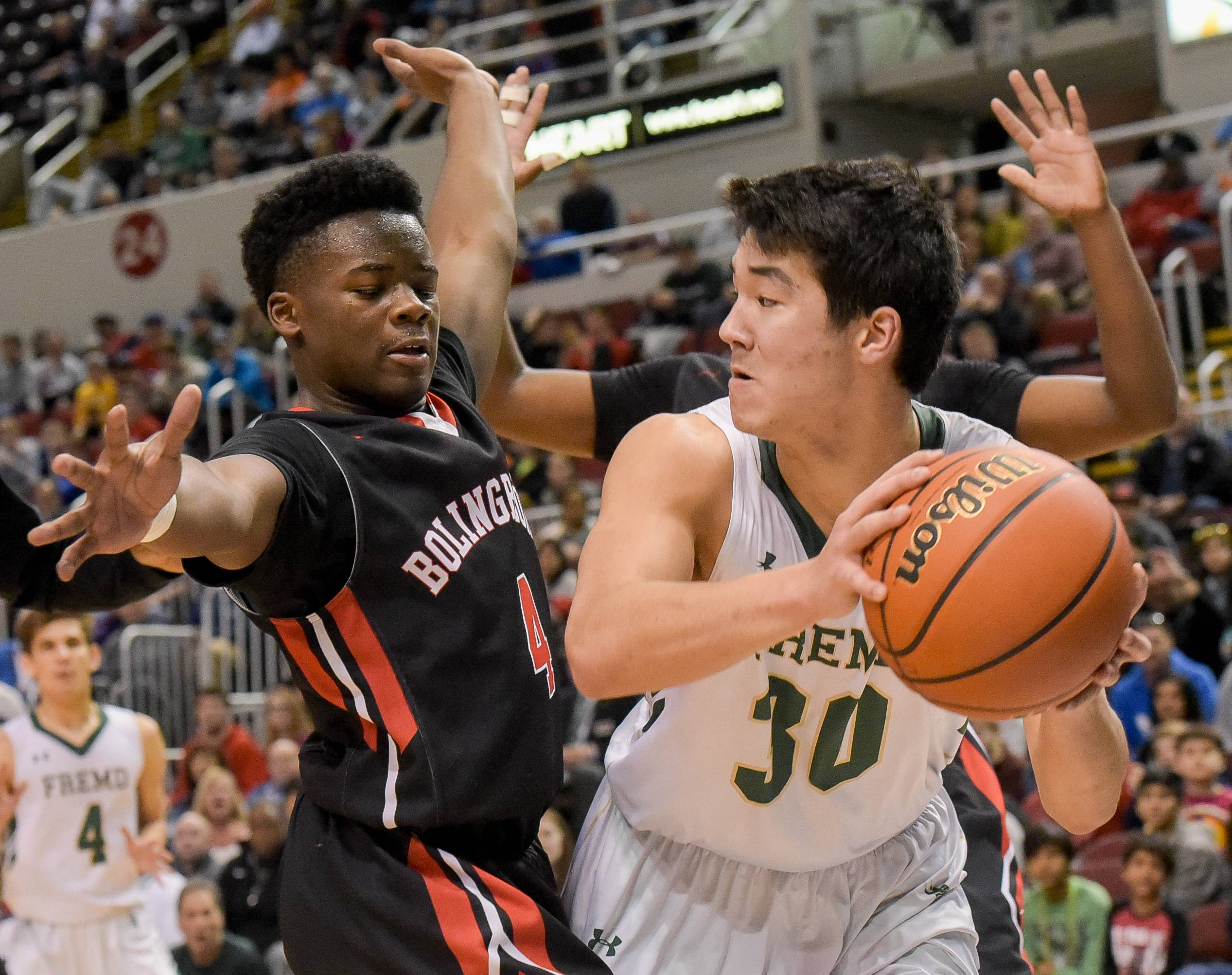 Fremd's Ryan Martin looks to pass around Bolingbrook's Isaiah Clemmons during the Class 4A third-place game on Saturday in Peoria.