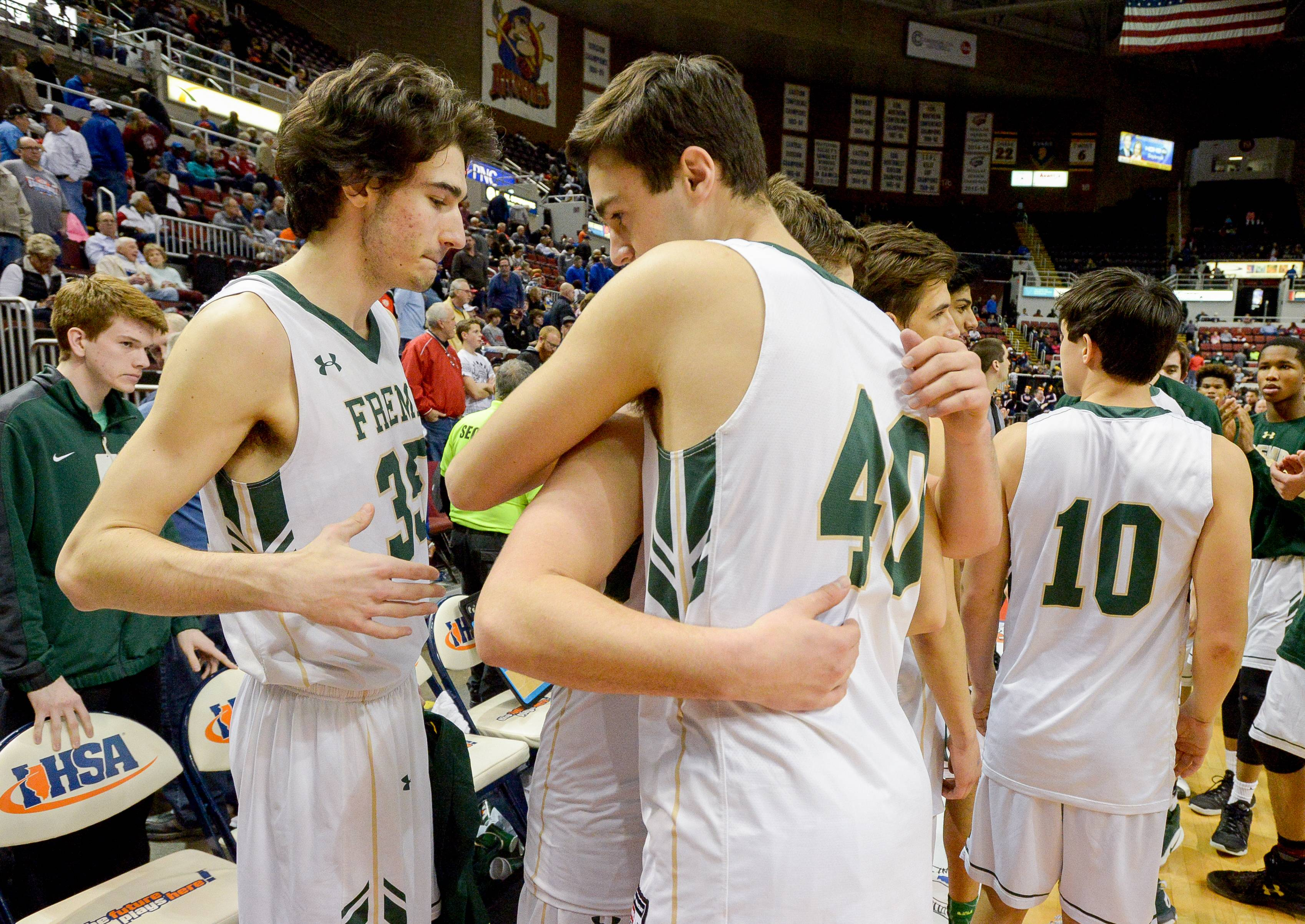 Fremd players console one another after a 70-66 loss to Bolingbrook in the Class 4A third-place game Saturday in Peoria.