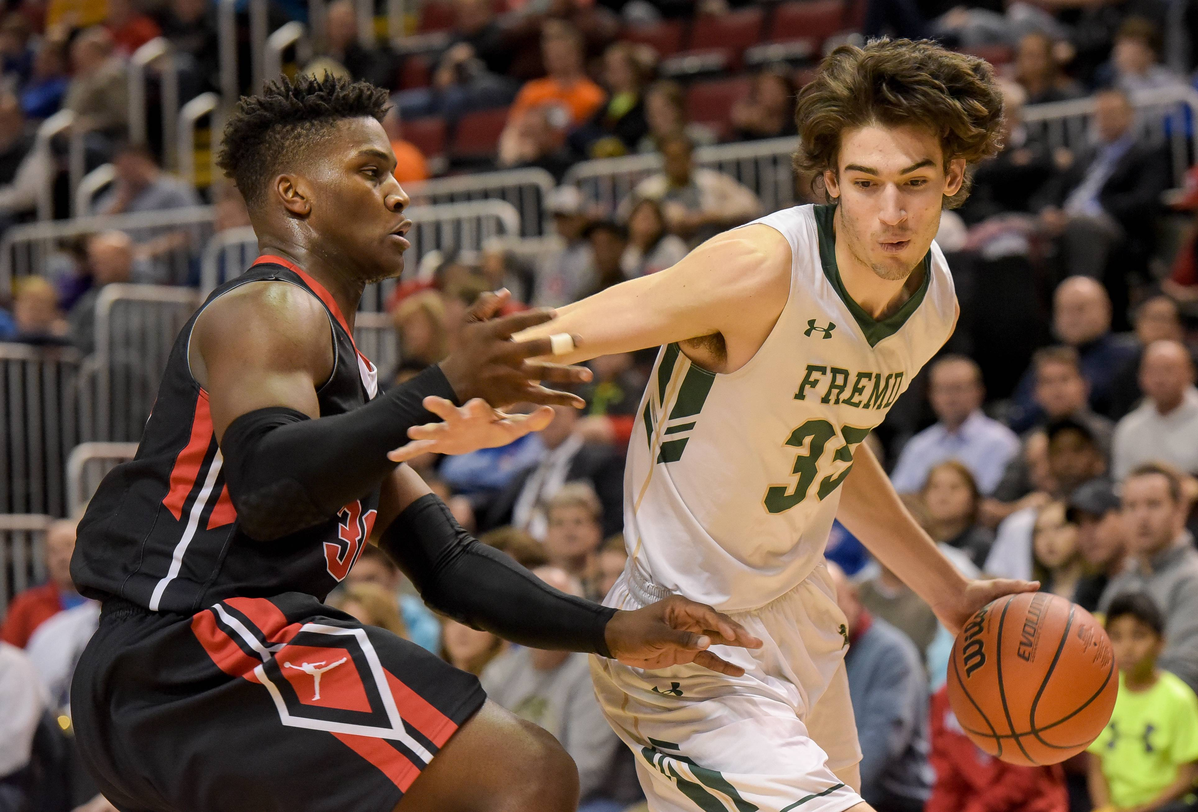 Fremd's Brian Dompke pushes around Bolingbrook's Malik Binns in the Class 4A third-place game Saturday in Peoria.