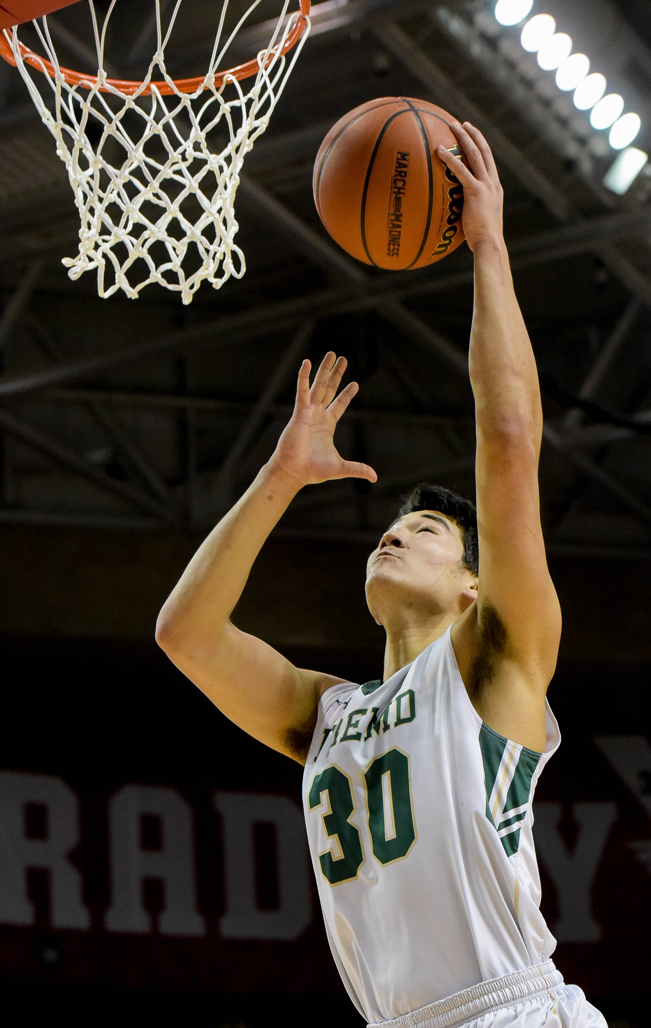 Fremd's Ryan Martin makes a layup during the Class 4A third-place game Saturday in Peoria.