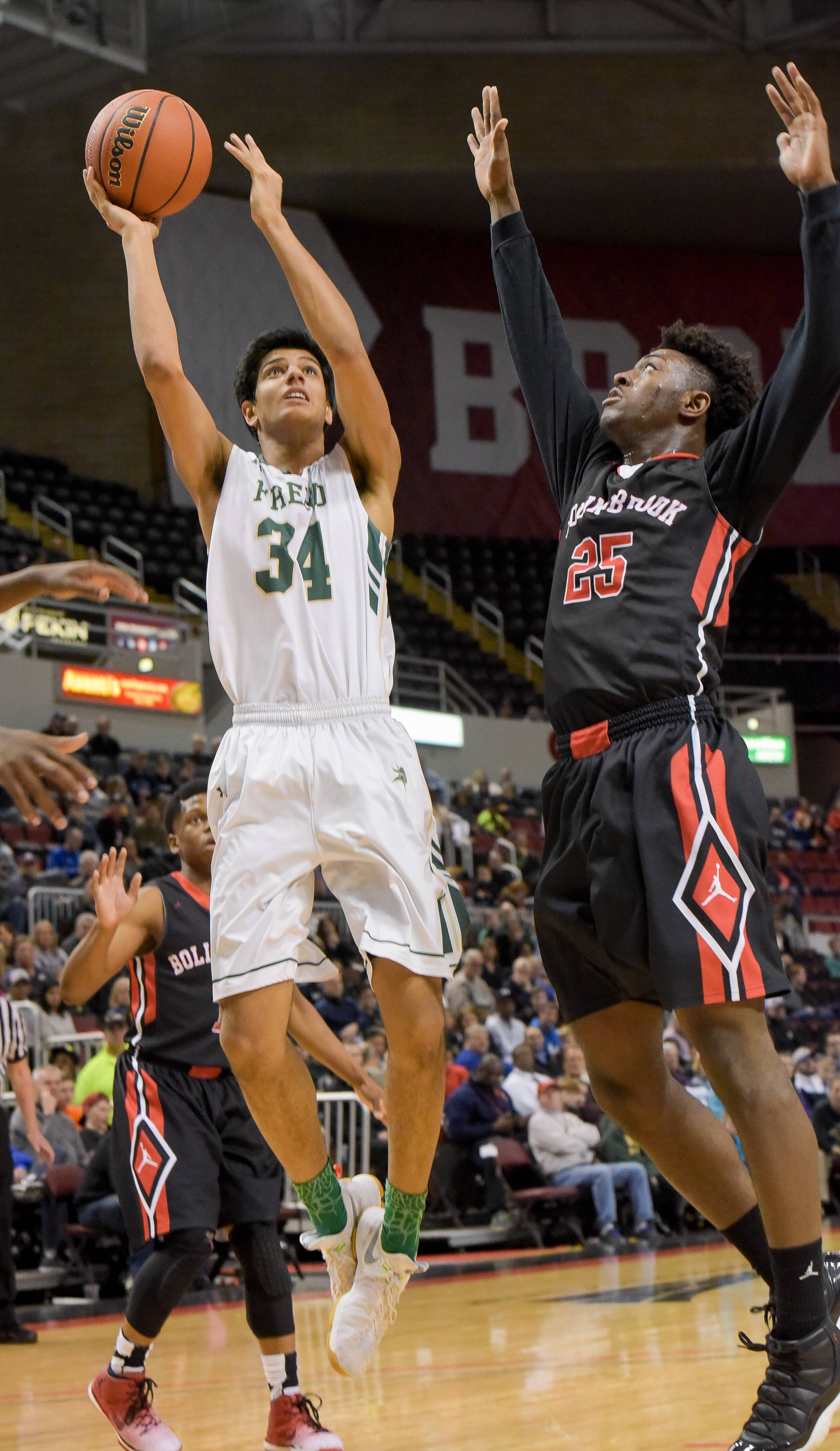 Fremd's Shaan Patel goes up for a shot after getting past Bolingbrook's Nana Akenten during the Class 4A third-place game Saturday in Peoria.