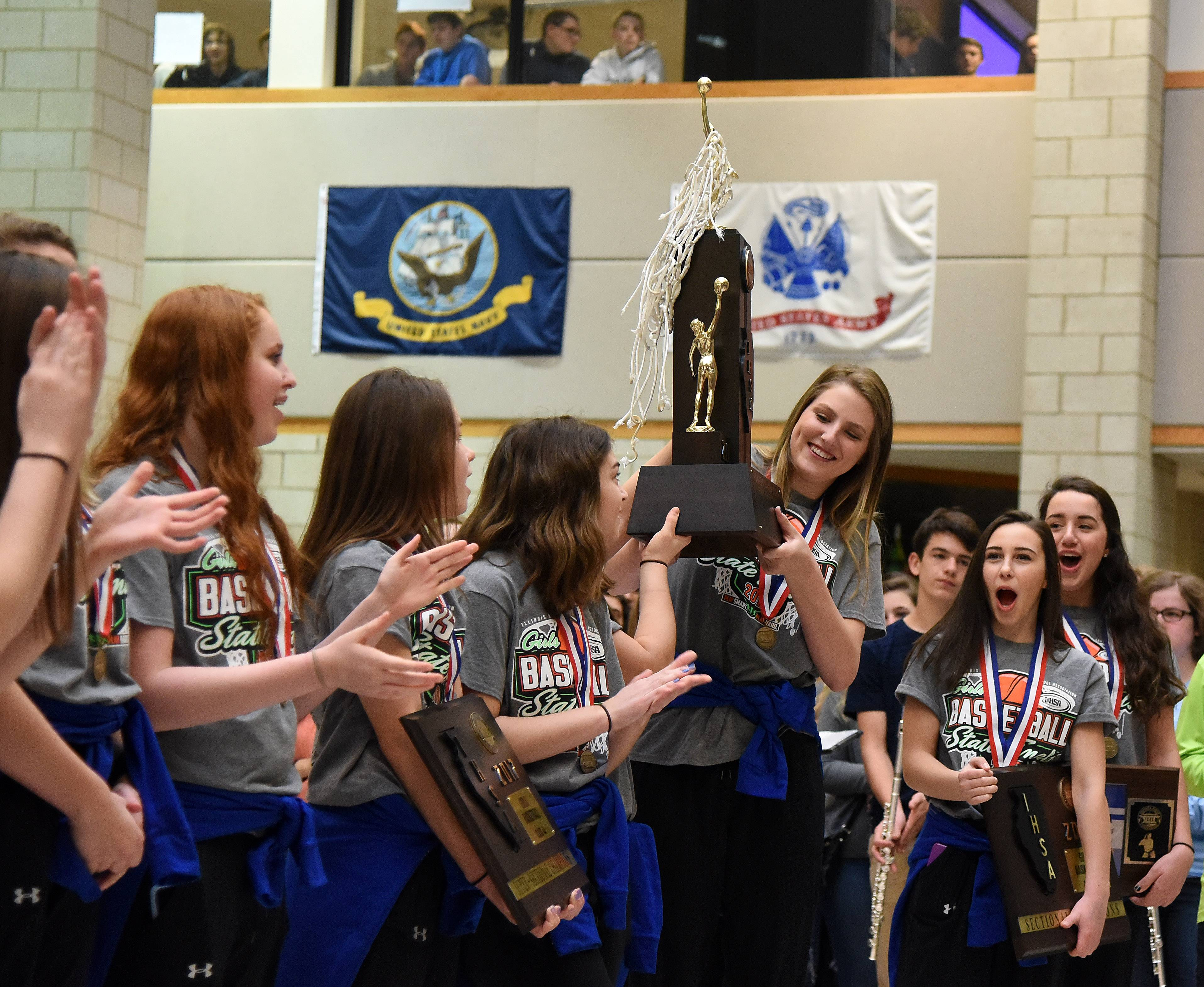 Geneva's Grace Loberg, pictured with the Class 4A girls basketball state championship trophy at a school pep rally in March, is the Fox Valley Female Athlete of the Year.