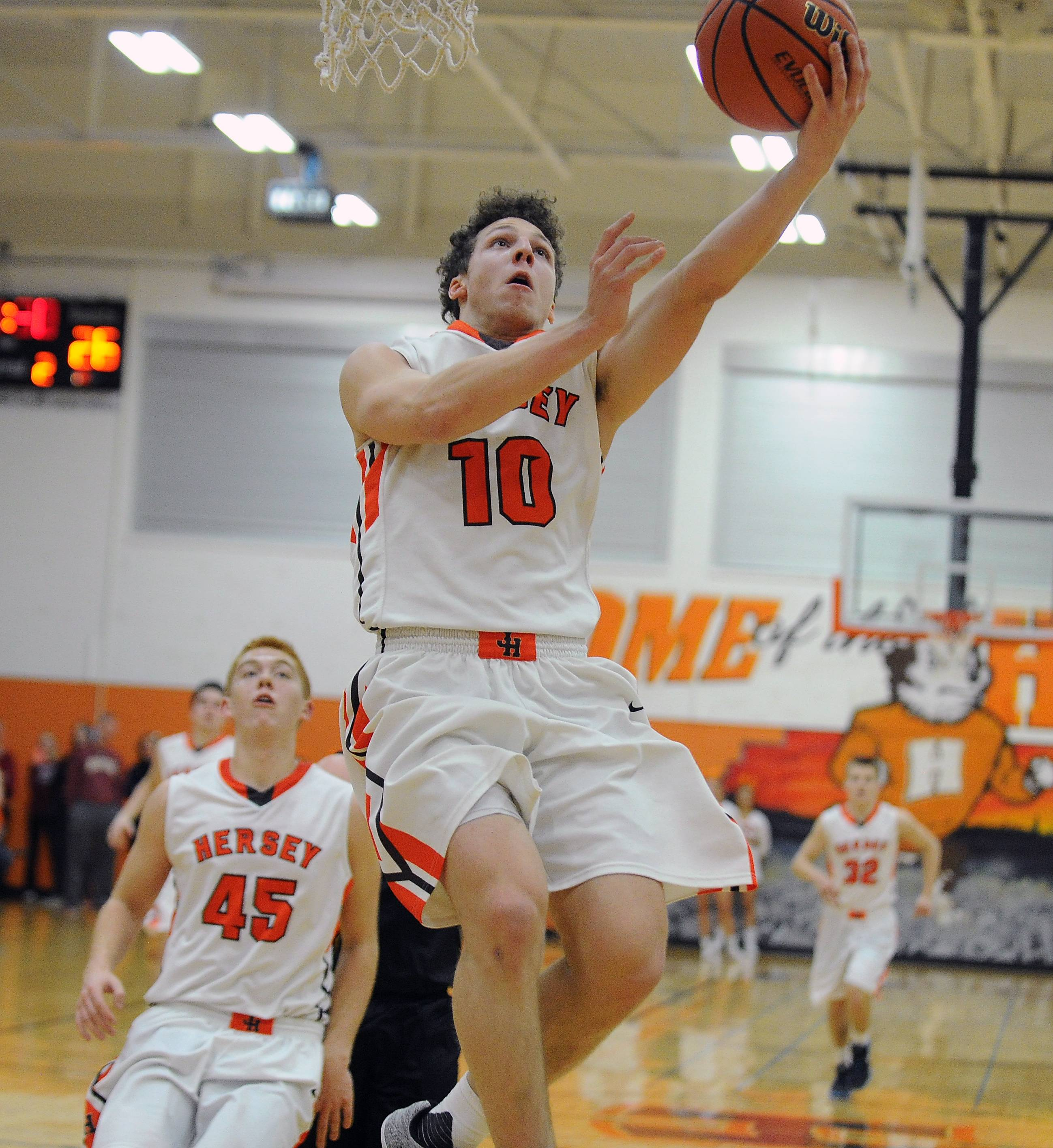 Hersey's Joey Coffaro, here getting to the hoop against Rolling Meadows, will join South Florida's men's basketball program coached by Brian Gregory.