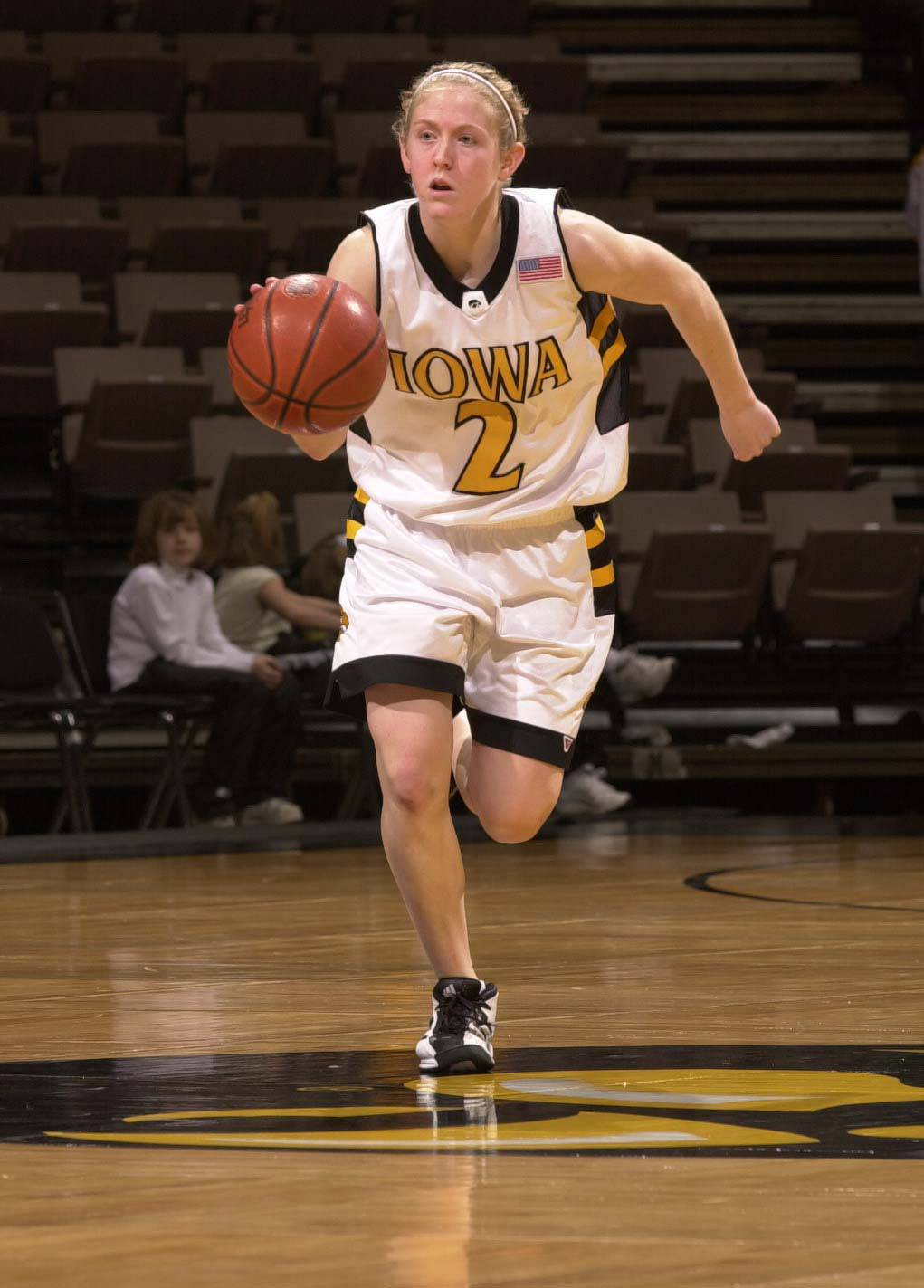 Kristi Faulkner, former Glenbard West all-state basketball player, now playing at Iowa. 2002