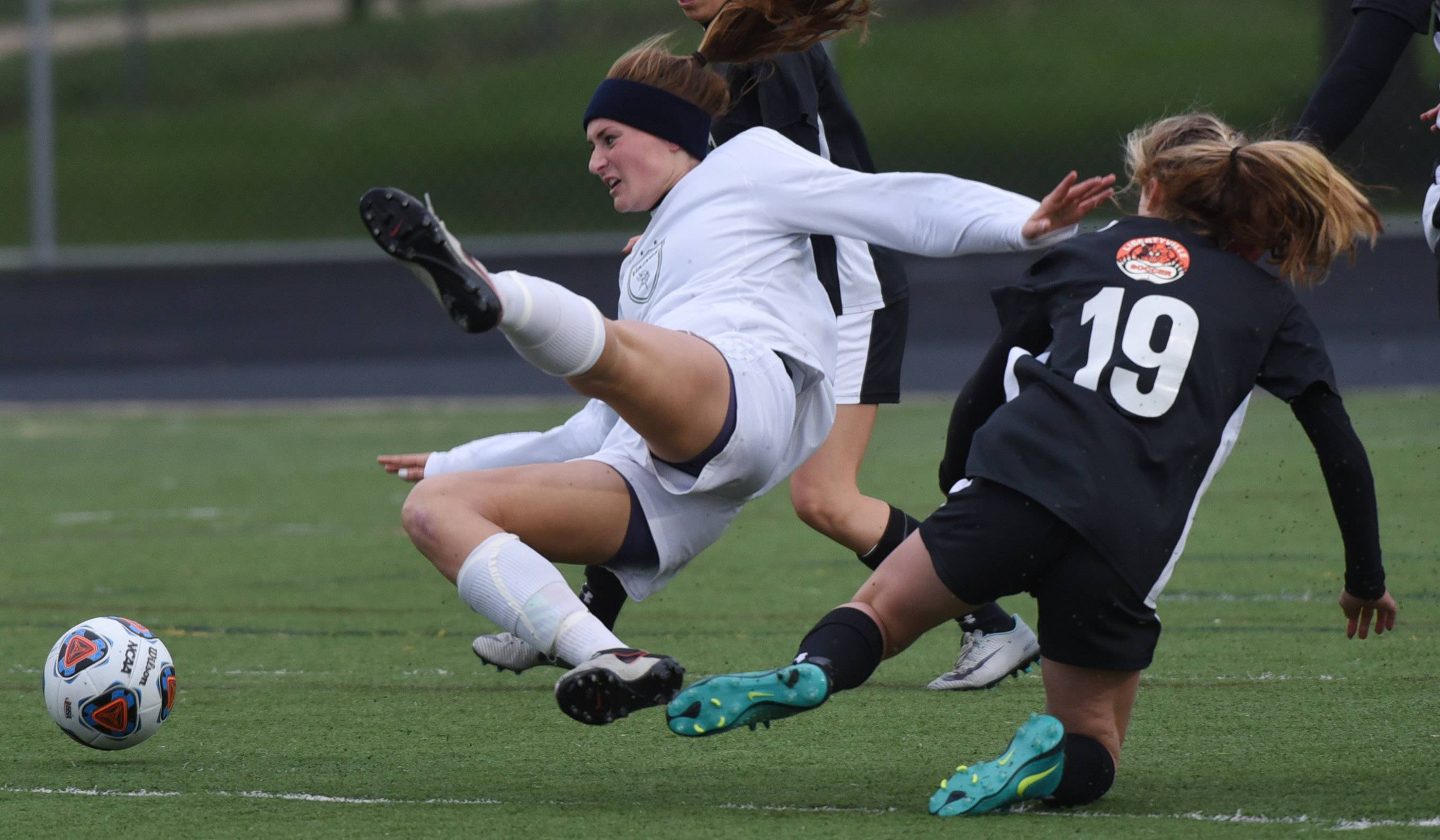 Fremd's Missy Adrian hits the turf hard after coming into contact with Libertyville's Morgan Verbeten during the Class 3A girls soccer playoff action this spring.