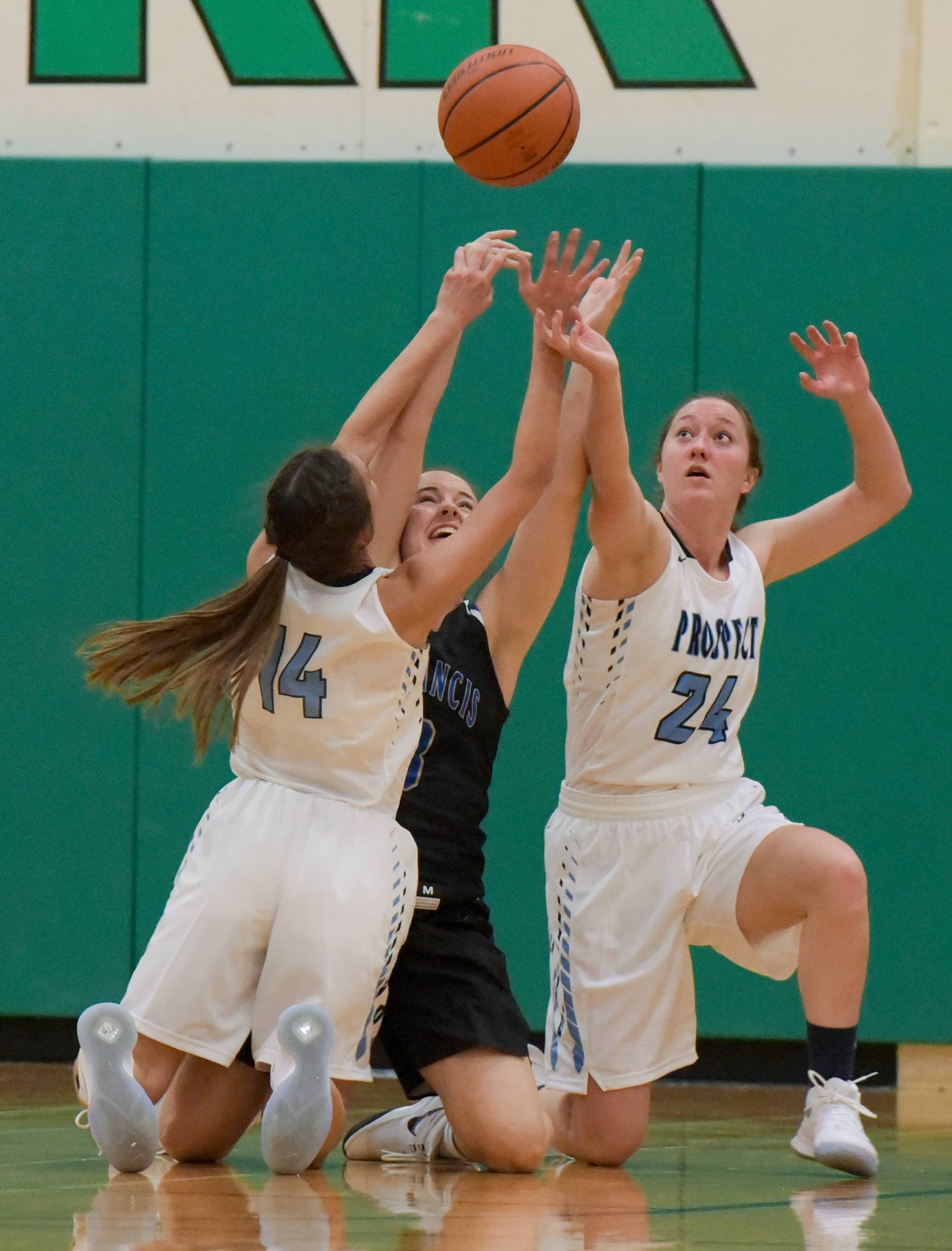 Prospect's Stephanie Kowalczyk and Ashley Adams struggle for control of the loose ball with St. Francis' Bella Burke girls basketball at York tournament on November 13, 2017.