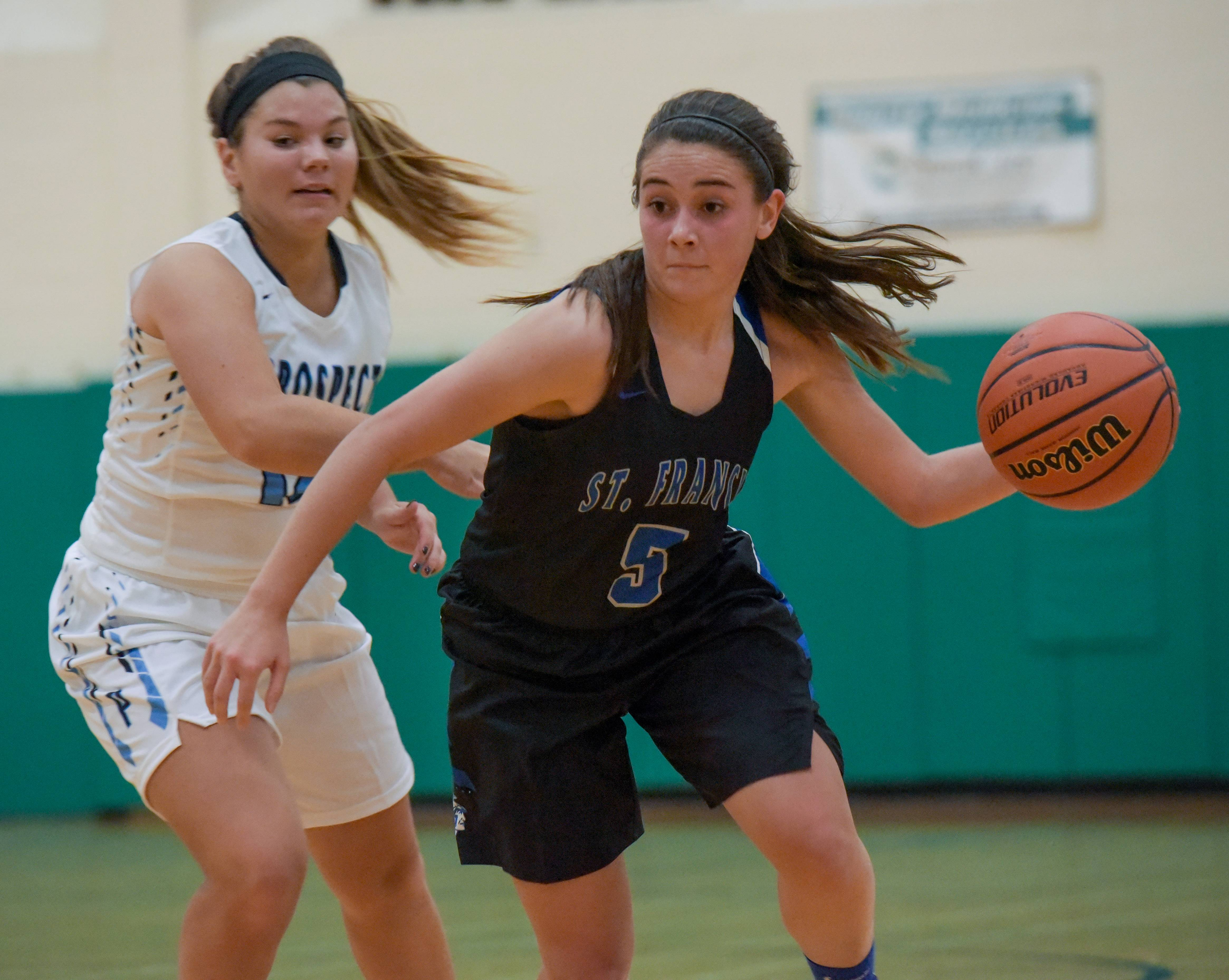 St. Francis' Kate Chaparro drives around Prospect's Margherite Pettenuzzo during the York Thanksgiving girls basketball tournament on November 13, 2017.