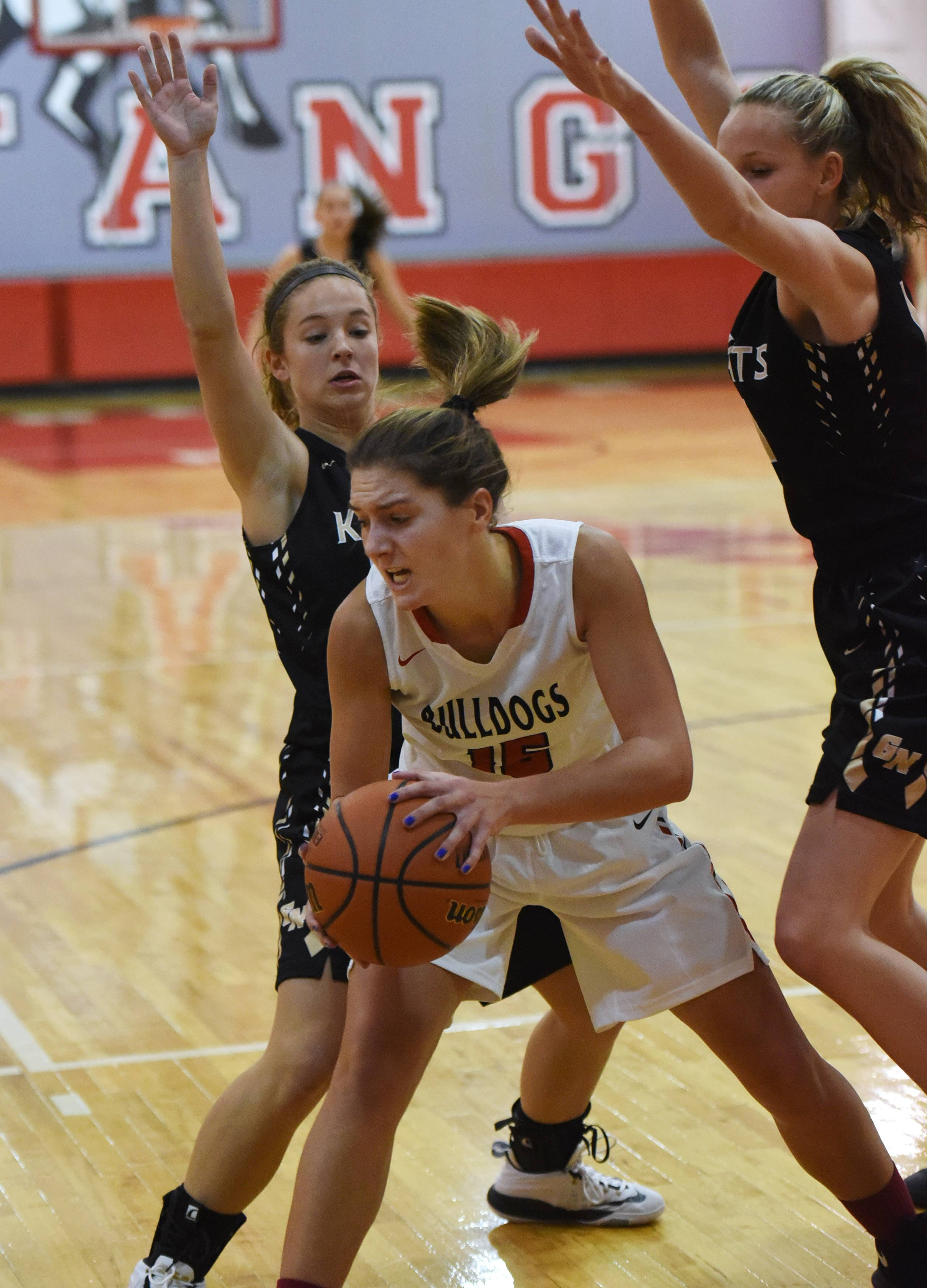 Grant's Kennedy Kiesgen, center, is pressured by Grayslake North's Faith Standerski, left, and Abbey Guenther on Monday at Mundelein's Thanksgiving tournament.
