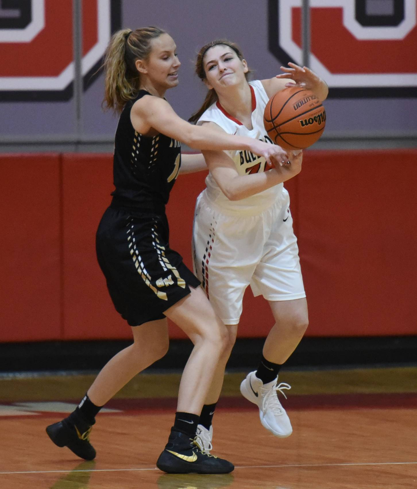 Grayslake North's Abbey Guenther, left, pressures Grant's Brooke Karpinske Monday at Mundelein's Thanksgiving tournament.